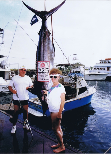 """My wife Kay & me posing next to the large fish (325-lb) I caught off of the Kona coast of HI. I was using 30-lb test line with relatively light tackle (rod & reel). I was a light tackle deep sea fisherman for most of my younger years. June 1990."""