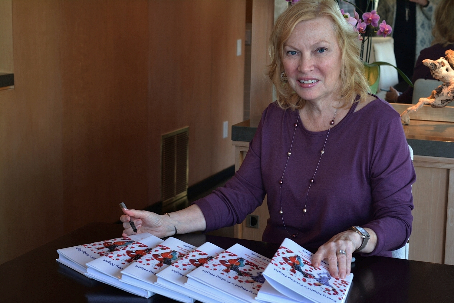 Andrea Signs Book.jpg