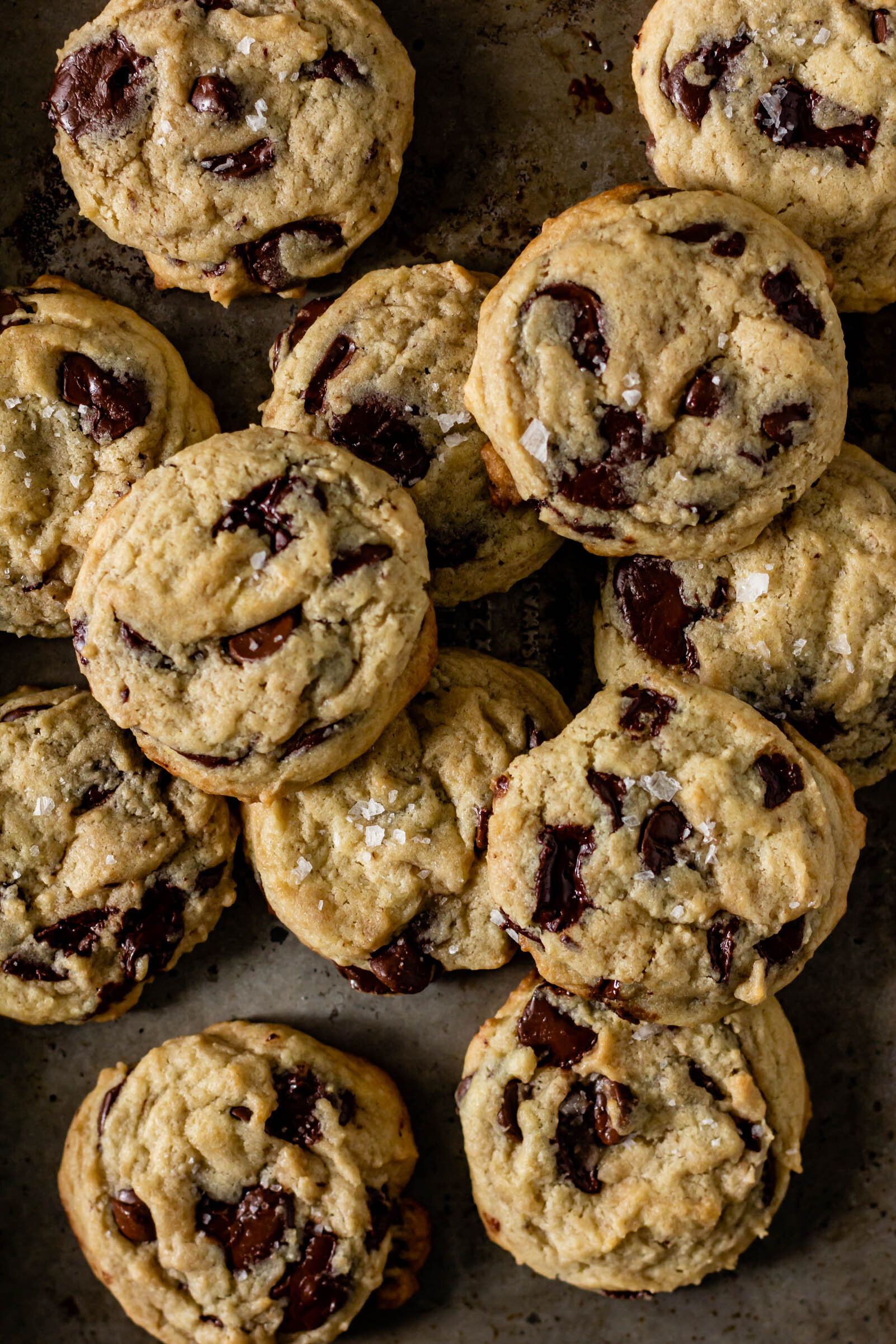 sourdough chocolate chip cookies on a baking tray.
