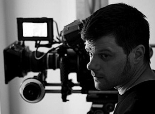"""ALAN JACOBSEN - CINEMATOGRAPHER   Alan Jacobsen photographs narrative and documentary projects with an authentic natural eye and sensitive curiosity. He filmed Yance Ford's Oscar Nominated """"Strong Island"""" and his films for two-time Oscar nominated director Marshall Curry: """"Racing Dreams"""" and """"Point and Shoot"""" both received the Grand Jury Prize for Best Documentary at the Tribeca Film Festival. """"The Trials of Darrel Hunt"""" won the Audience Award at Full Frame, was nominated for the Sundance Grand Jury and Independent Spirits awards, and was shortlisted for the Academy Award. Alan's breakout narrative feature """"Toe to Toe"""" was nominated for the Grand Jury and Cinematography Awards at the Sundance Film Festival, and his ribald comedy """"The Auteur"""" premiered at The Tribeca Film Festival, becoming a midnight cult favorite as Cinetic Media's inaugural CRM release. In addition to short-form and commercial work for directors including Peter Sillen, Jeremy Saulnier, Annetta Marion, and Morgan Spurlock, Alan is currently shooting a feature doc with His Holiness the 14th Dalai Lama, as well as """"Finding 52- The Search for the Loneliest Whale"""", for Josh Zeman and Adrian Grenier."""