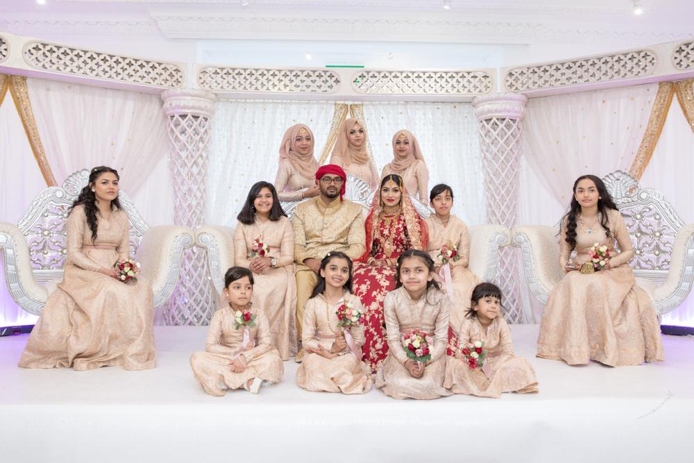 Female-asian-wedding-photographer-London-Ariana-Gardens-natalia-smith-photography-group-photo-32.jpg
