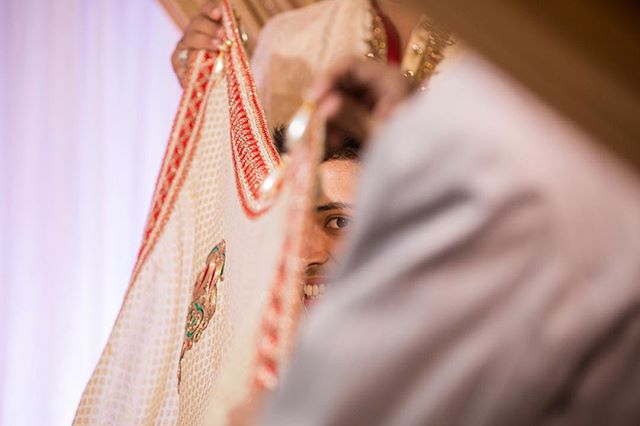 That moment before the curtain is lowered and the groom gets to see his bride for the first time. Meanwhile - a little sneak peak.⠀ ⠀ ⠀ ⠀ -------------------------------------⠀ ⠀ -------------------------------------⠀ ⠀  #indianweddingz #hinduwedding #jaimala #mandap #weddingplz #weddingsutra #weddingbells.x #wedding_life #indian_wedding #indian_wedding_inspiration @globe_people @wedding_life @indianweddingz @weddingplz @weddingsutra  @weddingbells.x @wedding_life @indian_wedding @indianbridesx @indian_wedding_inspiration @indianbride #photobugcommunity @junebugweddings @wedding.photo.inspiration @herbigdayllc ⠀ #vscocam⠀ #heyheyhellomay⠀ #huffpostweddings⠀ #huffpostido⠀ #clickinmoms⠀ #sisterphotogs⠀ #magnoliarouge⠀ #stylemepretty⠀ #smpweddings⠀ #buzzfeedweddings⠀ #loverly⠀ #kinfolk⠀ #rfwppi⠀ #natgeoinspires #asianweddingphotographer #femalephotographer #weddingphotographer #свадебныйфотограф