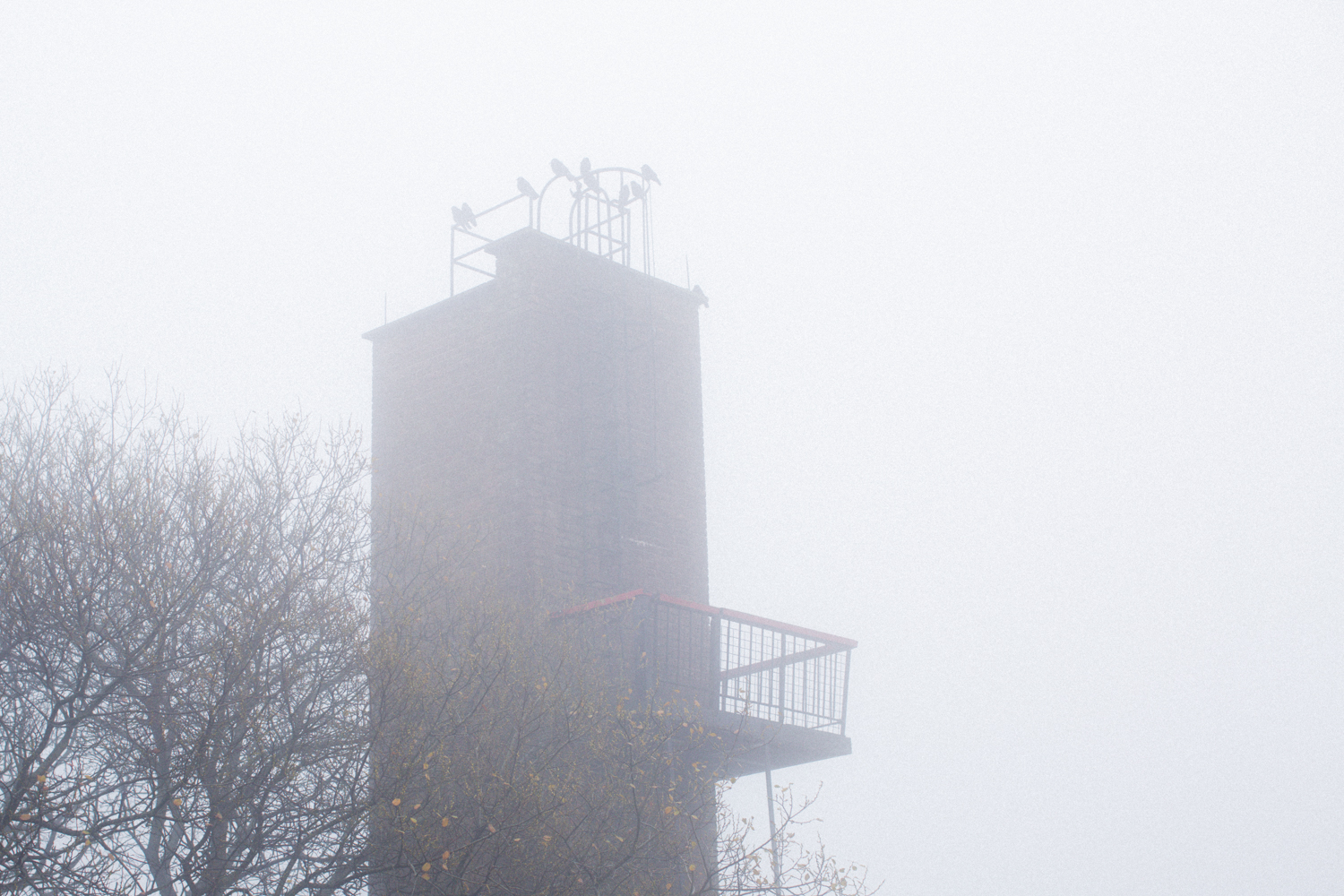 The fire tower creates a dominating sensation in the area.