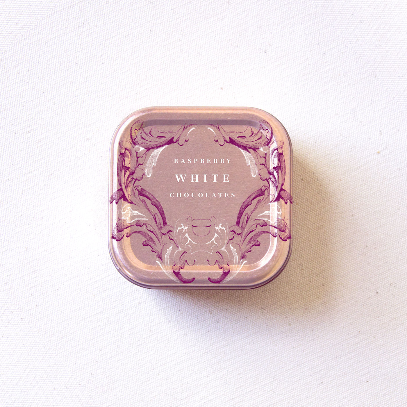 Rococo-inspired raspberry white chocolate metallic package illustration by Laura Dreyer.