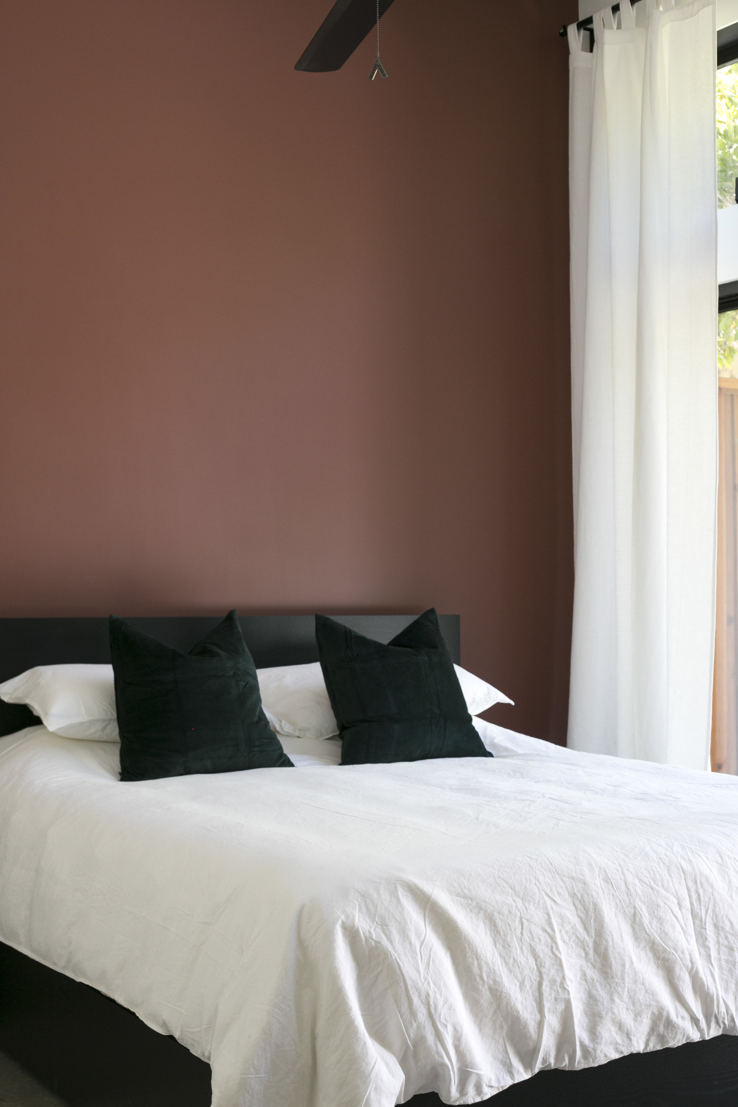 switch-house-bedroom-accent-wall-white-curtains.jpg