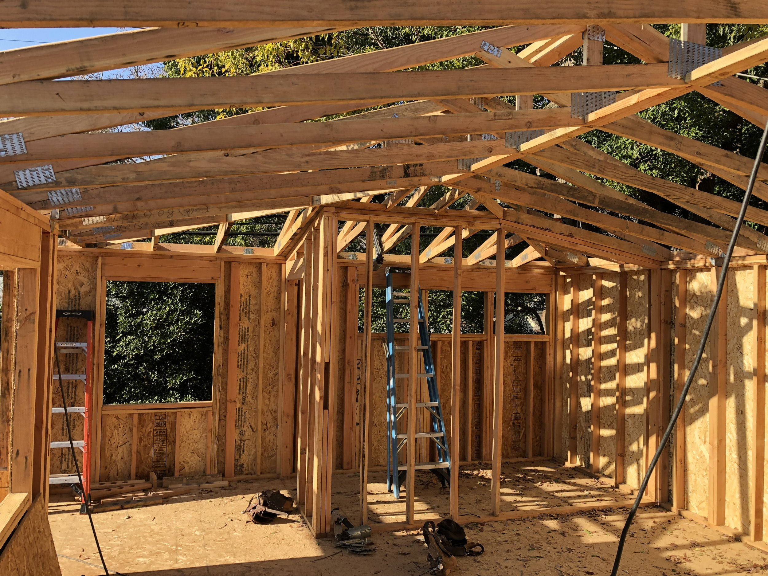 2-story-glass-block-studio-construction-framing-trusses-windows.jpeg
