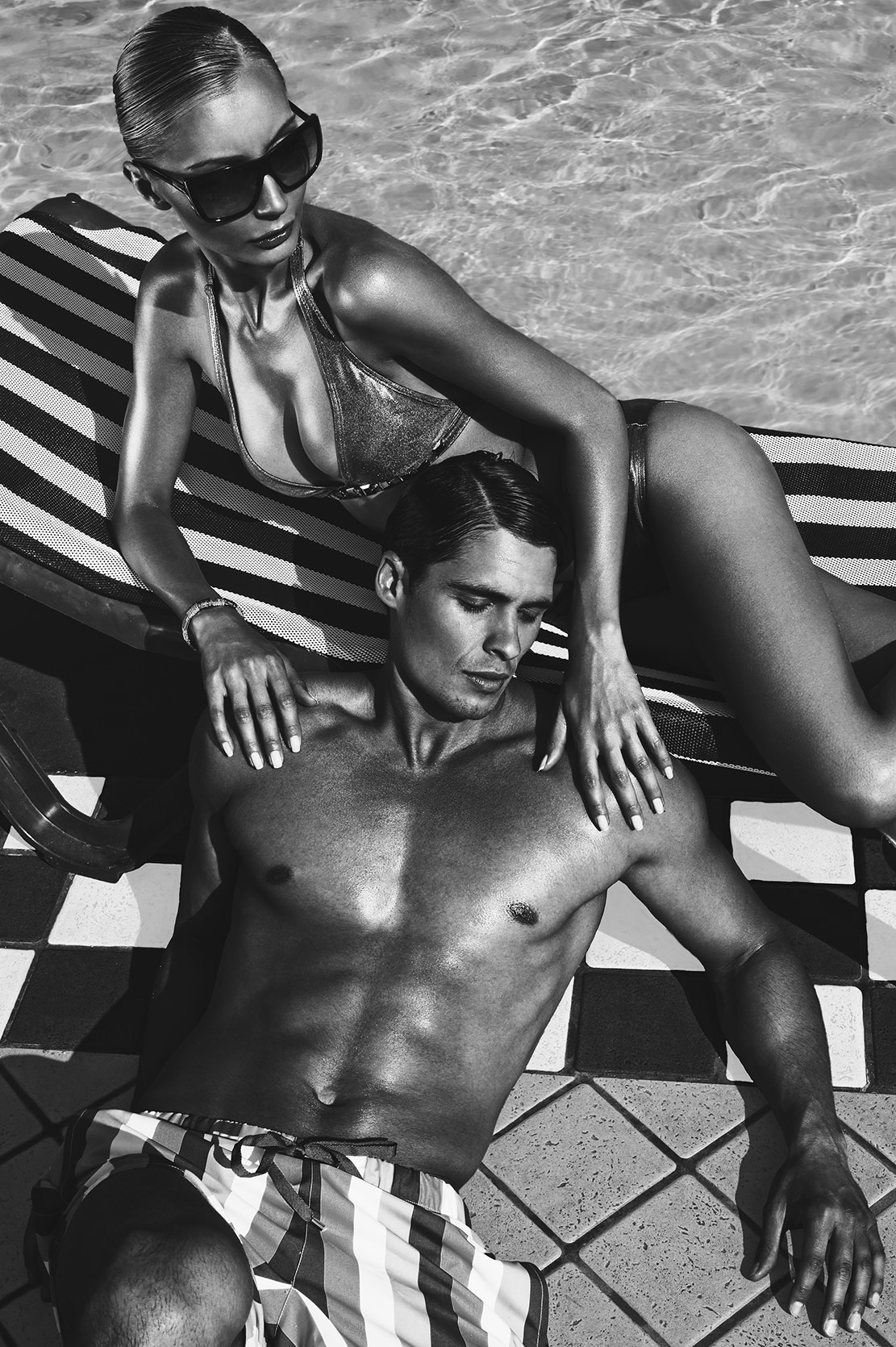 fashion-couple-by-the-pool-on-the-sun.jpg