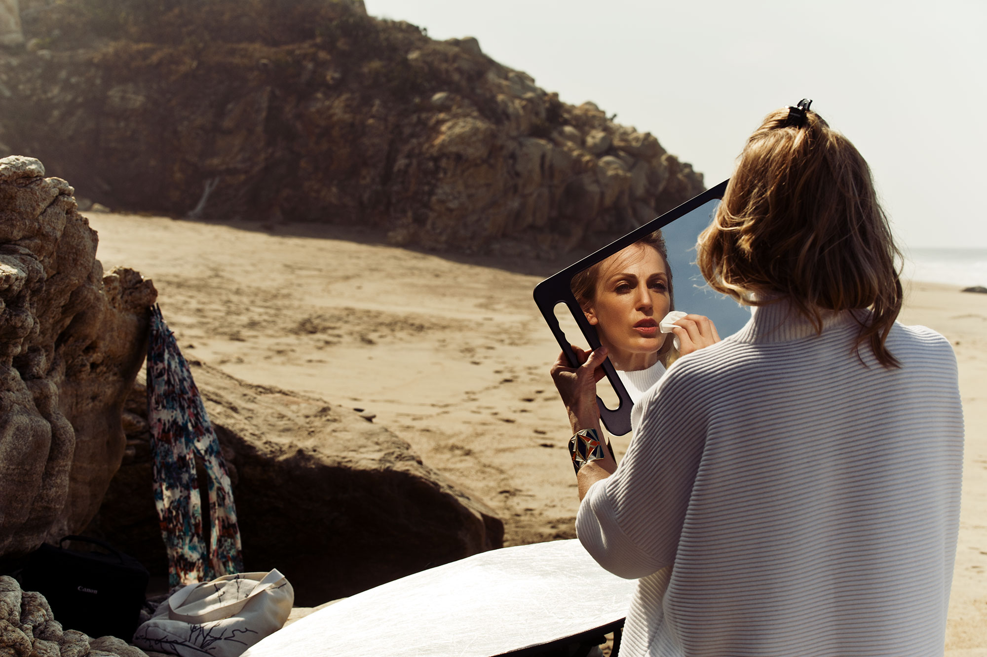 Puerto Escondido, Mexico. Behind the scene by the ocean of  a model prepping for the photo shoot.