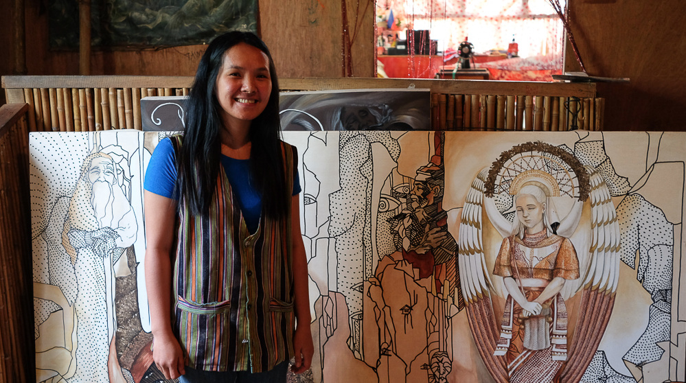 Salima Saway Agra-an with her paintings