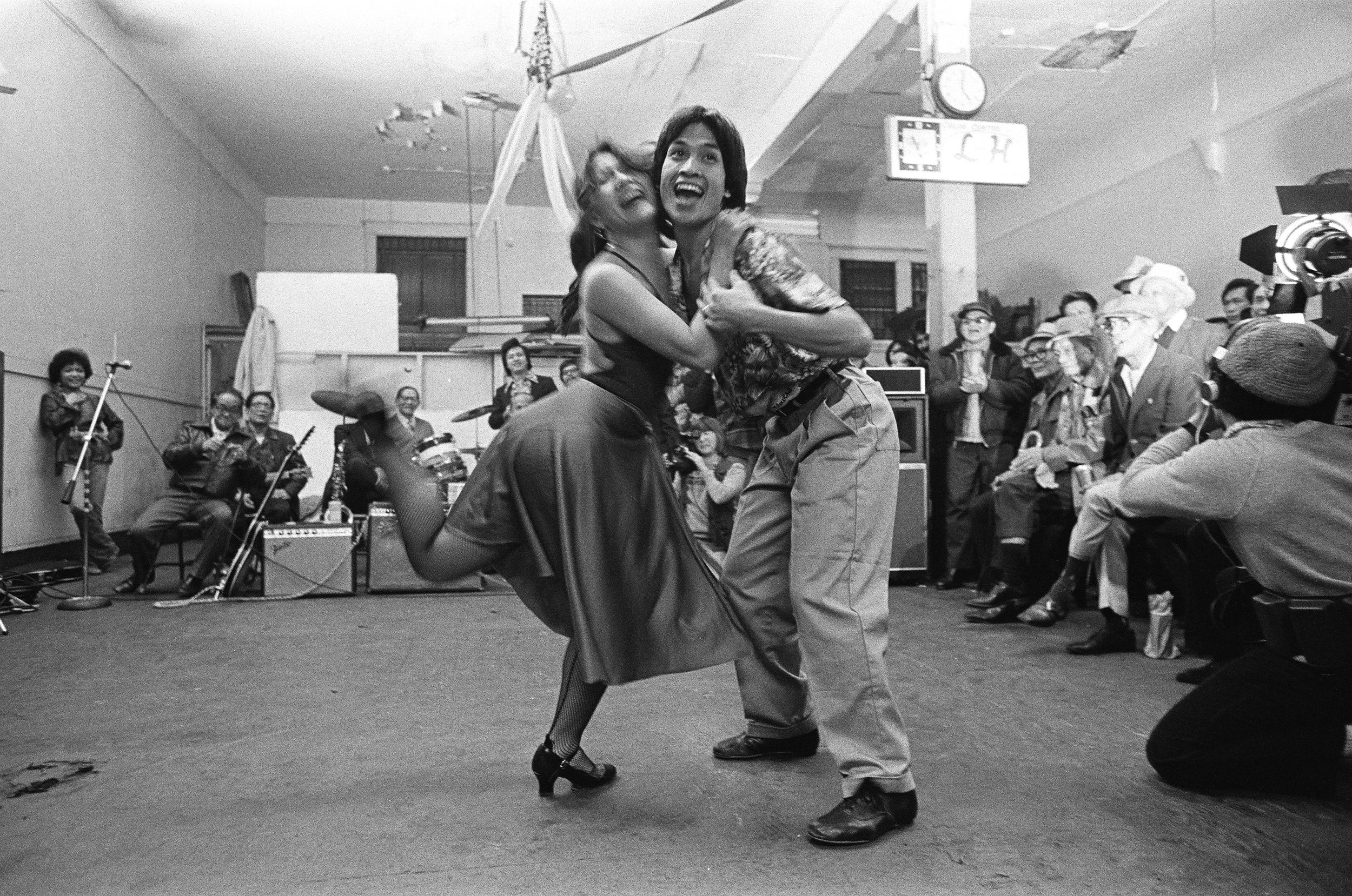 Evel Ante and Gregory R. De Silva dancing for I-Hotel residents in Lucky's Pool Hall on Kearny Street, c. 1970's