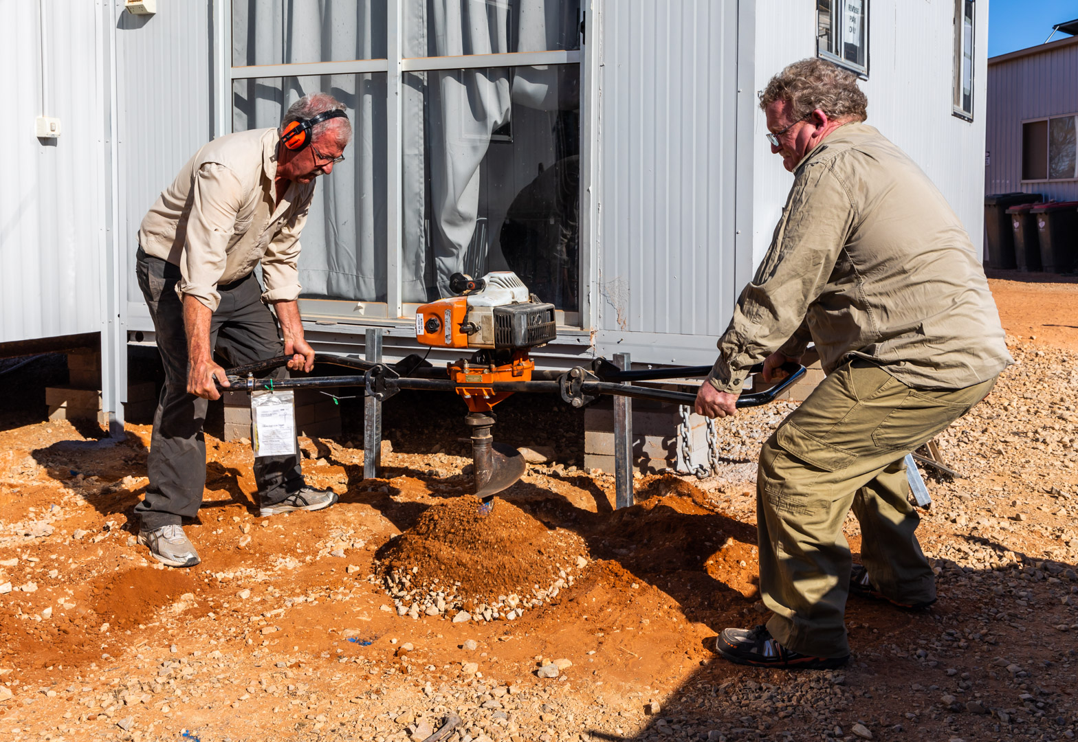 In 2018 we built a deck for the education room.  Robin Stewart & John Crompton drilling the stump holes for the deck.