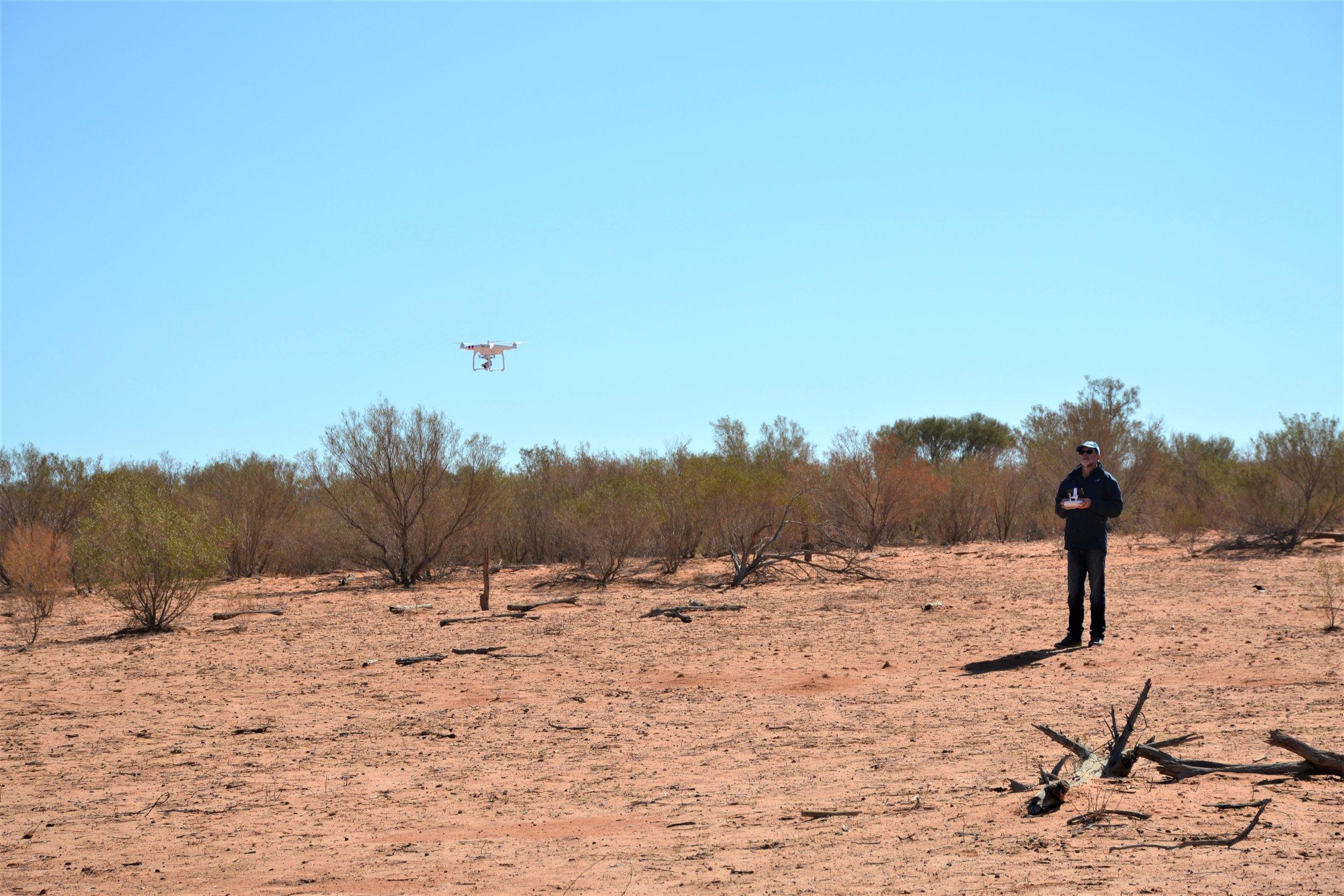 059 David & drone at woolshed.JPG