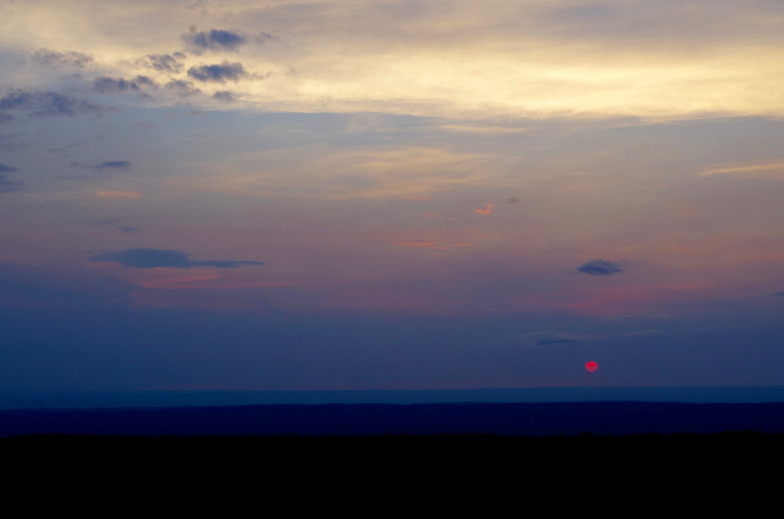 The solstice sun setting in the west. (Photo Credit: Trina Moyles)