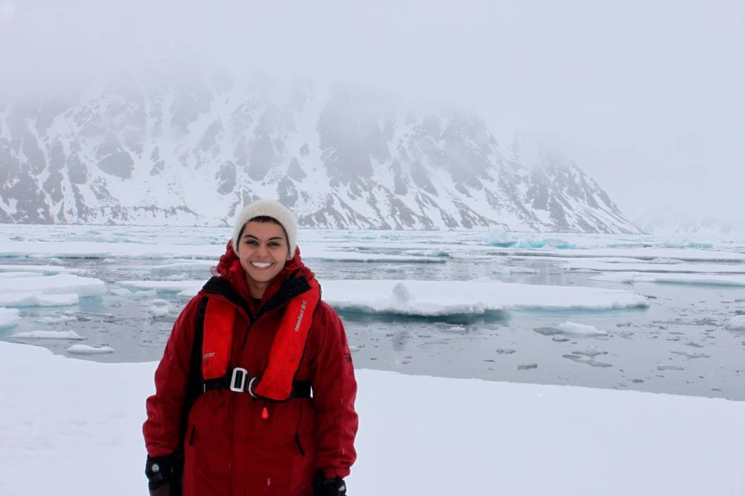 """The author, Jenna Butler, standing in front of """"old ice"""" in Norway's Arctic."""