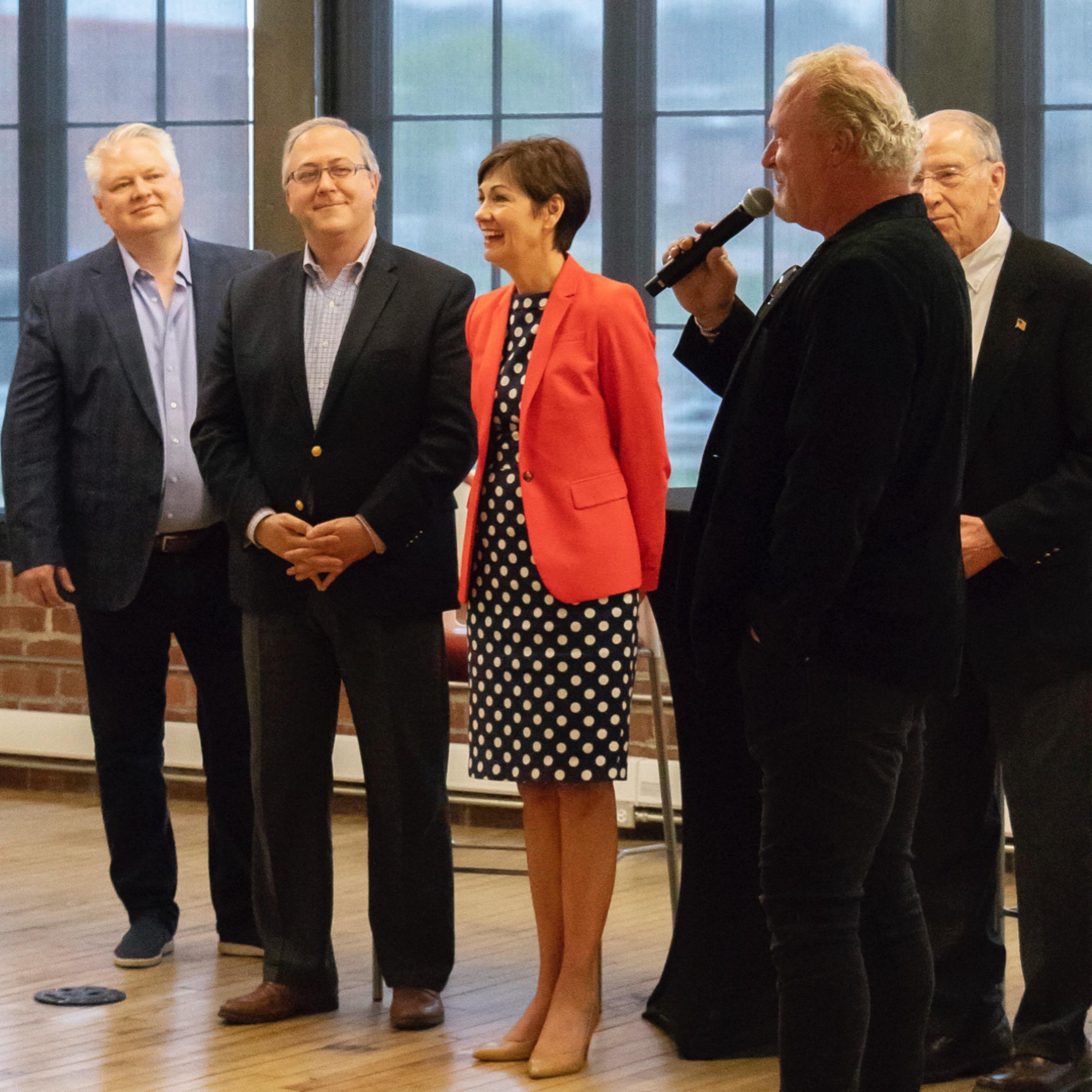 Linc Kroeger, Congressman David Young, Governor Kim Reynolds, Pillar Technology CEO Bob Myers, and Senator Chuck Grassley at The Forge