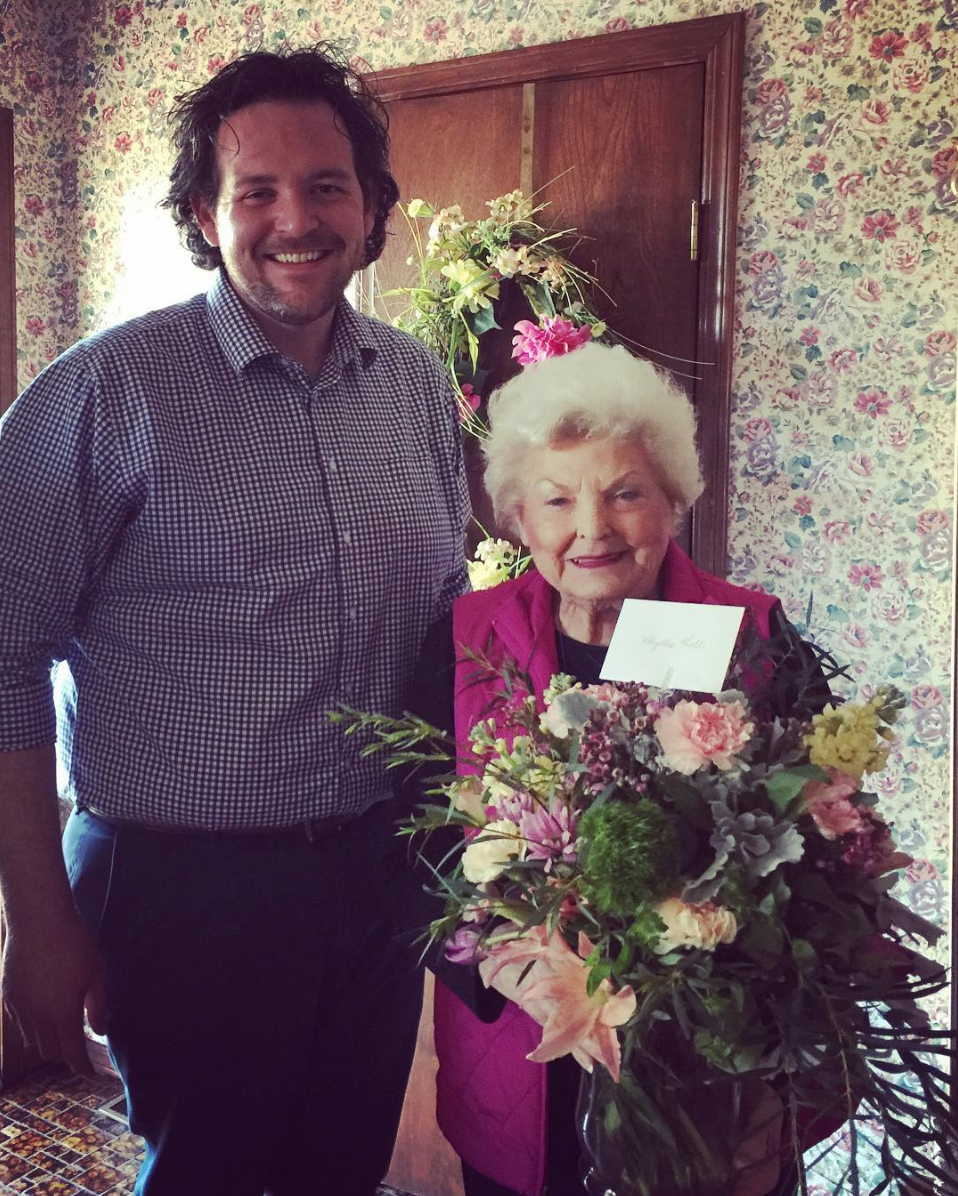 Heath with his first customer, Mrs. Phyllis