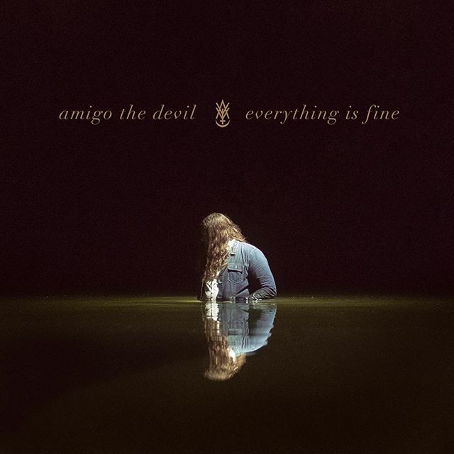 """IT'S FINALLY OUT!!! The first full length """"Everything Is Fine"""" by Amigo The Devil. This album means so much to me and the journey I've taken with him over the past decade has been such a crucial part of my life. Seeing him grow as an artist, I couldn't be more proud of this gem he has put out.  I found a review online today and this about sums up the album: """"Frankly, listening to this album on repeat is making me want to reach for a Lemmy or ten, and cry into my pillow about all my regrets, my misspent youth, all while I rethink my life so far."""" These are a bunch of photos,covers, and book pages from the weekend we spent making all the visuals for this album. NOW GO LISTEN TO IT AND BUY IT AND HAVE A CRY!! . . #amigothedevil #everythingisfine #album #albumartwork #murderfolk #newrelease #itunes #spotify #photography #design"""