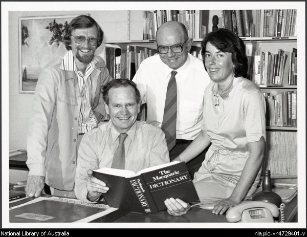 David Blair, Arthur Delbridge (seated), John Bernard, Sue Butler with the first edition of the Macquarie Dictionary