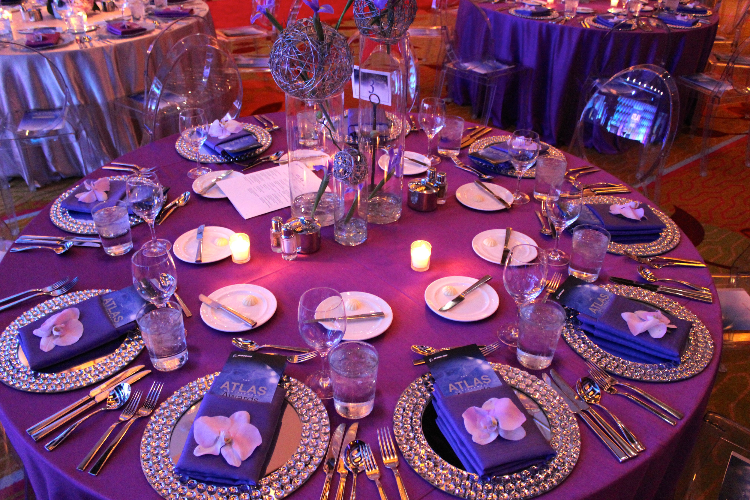 Mirrored Chargers, Shantung Napkin, and Orchid Accent