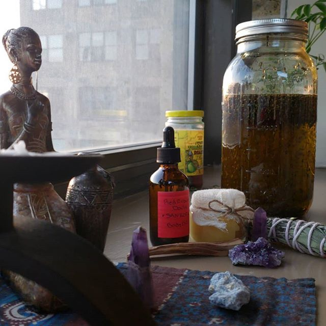Magic cooking in the sun on my window ledge. What a great place for solar/lunar infusions and ancestral infusions.  I'm infusing some olive oil with lavender and amethyst for my next round of body oils.  #herbs #solar #lunar #doula #postpartum #essentialoils #lavender #oliveoil #palosanto #amethyst #sage
