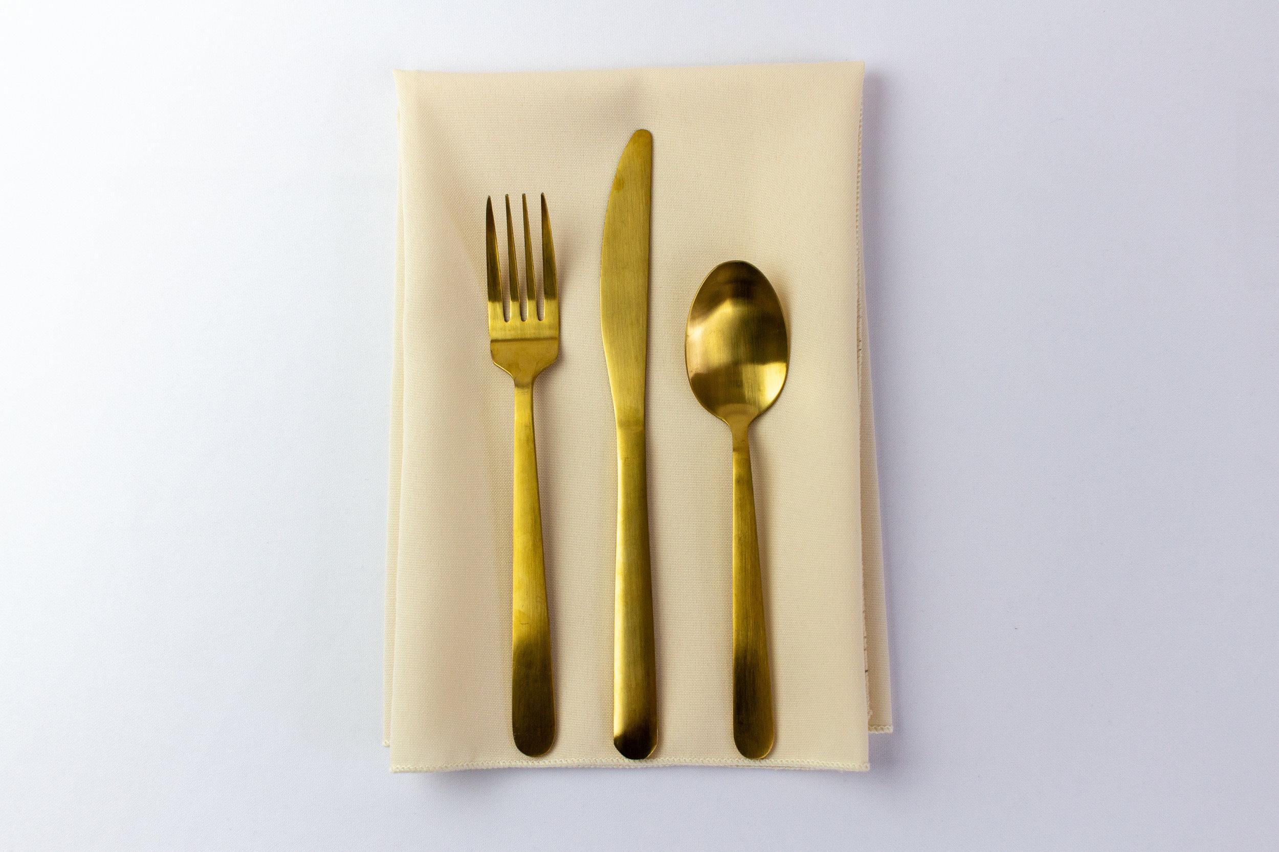 Milk Duds Napkin with Gold Stemware.jpg