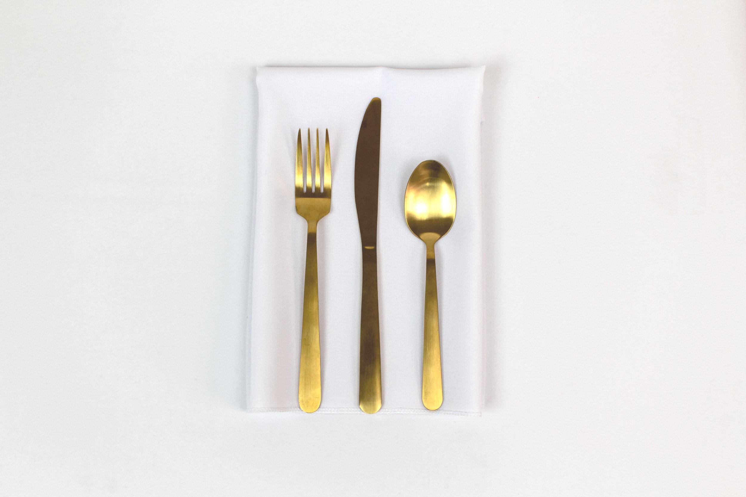 White Napkin with Gold Stemware.jpg