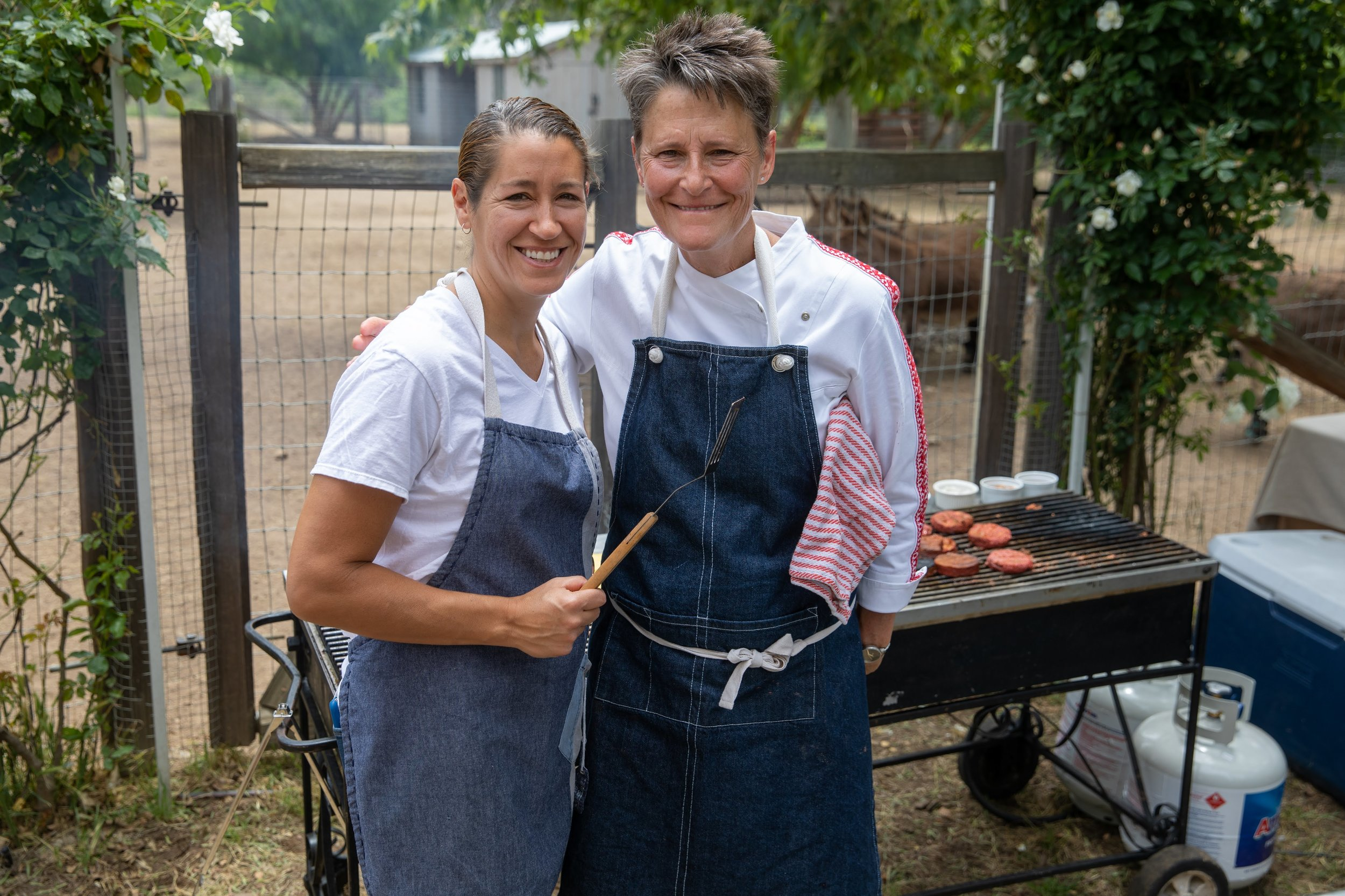 Our friends Lisa and Emily who volunteered their time to handle all the grilling. We served Beyond Meat burgers with Violife cheese.. SOOOO GOOD!