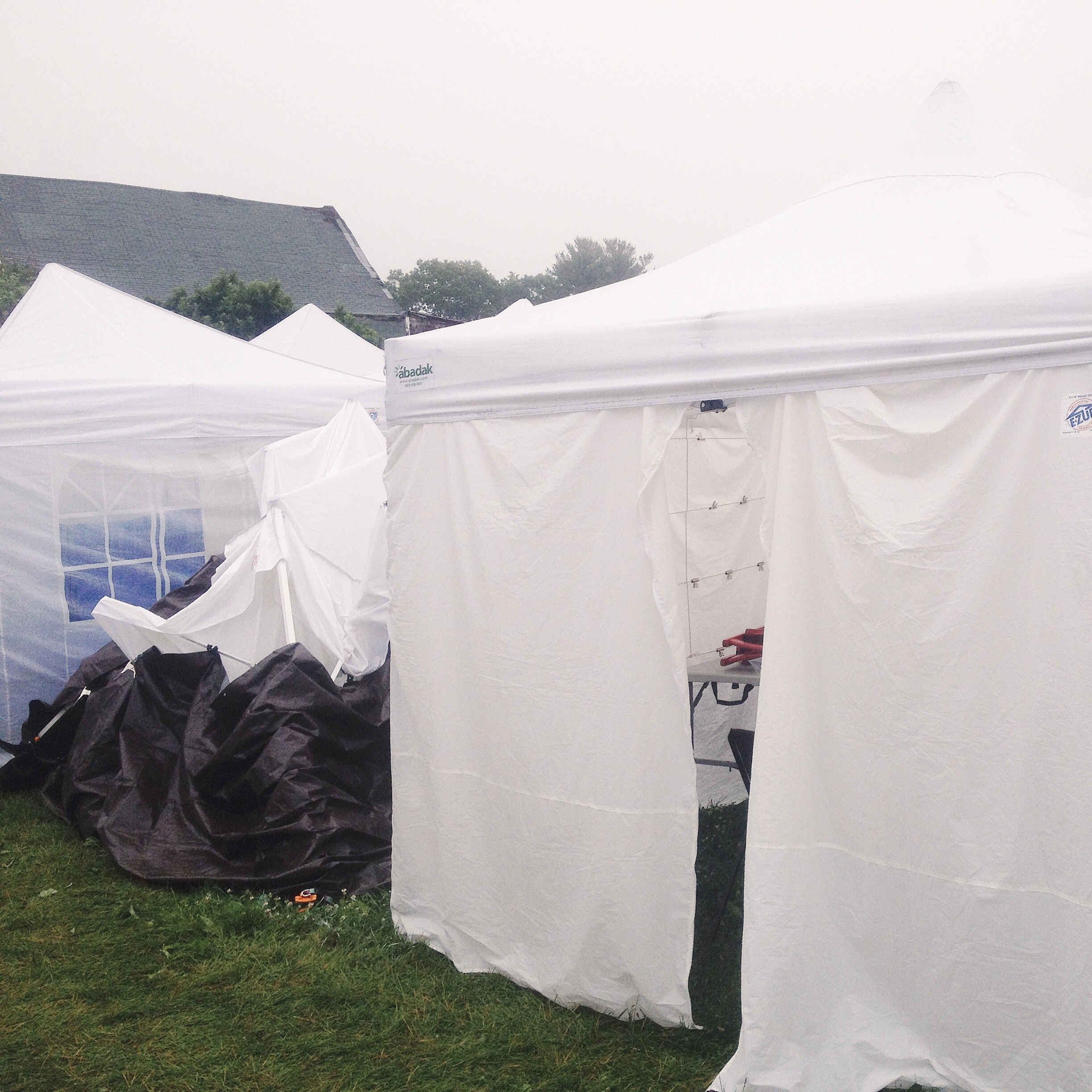 Heavy rains collapsed our neighbors tent at Vintage Bazaar