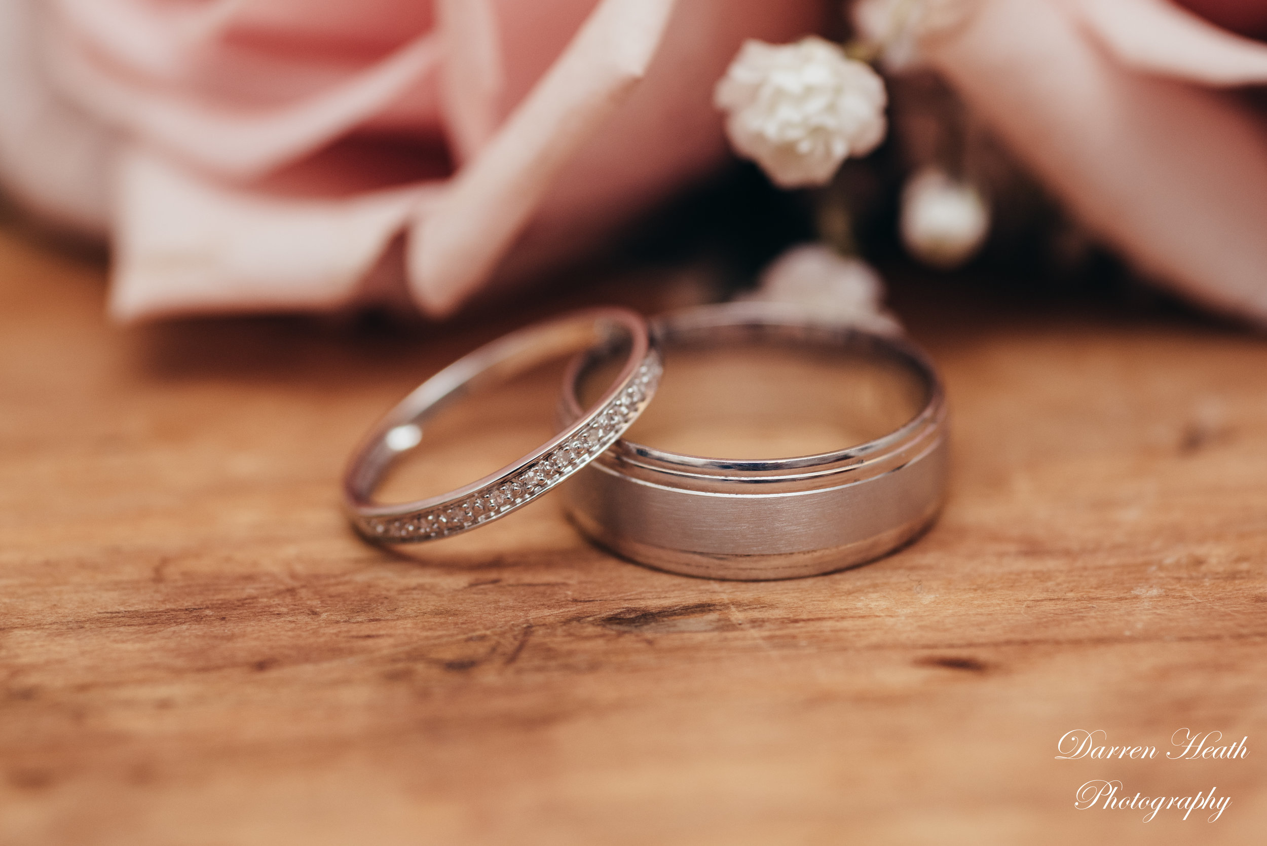 Both wedding rings in front of buttonhole