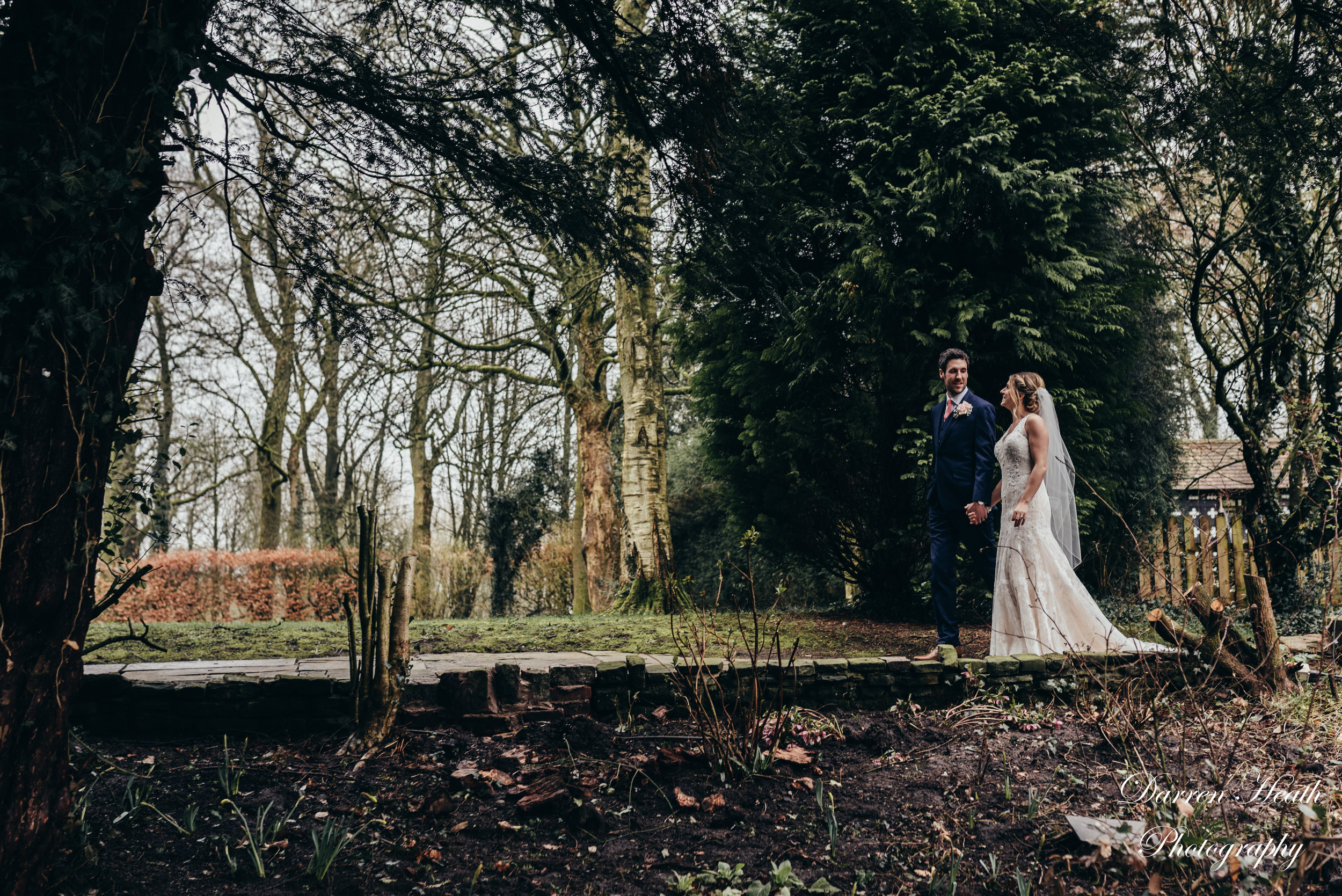 Bride and Groom take time to explore the grounds at Samlesbury Hall