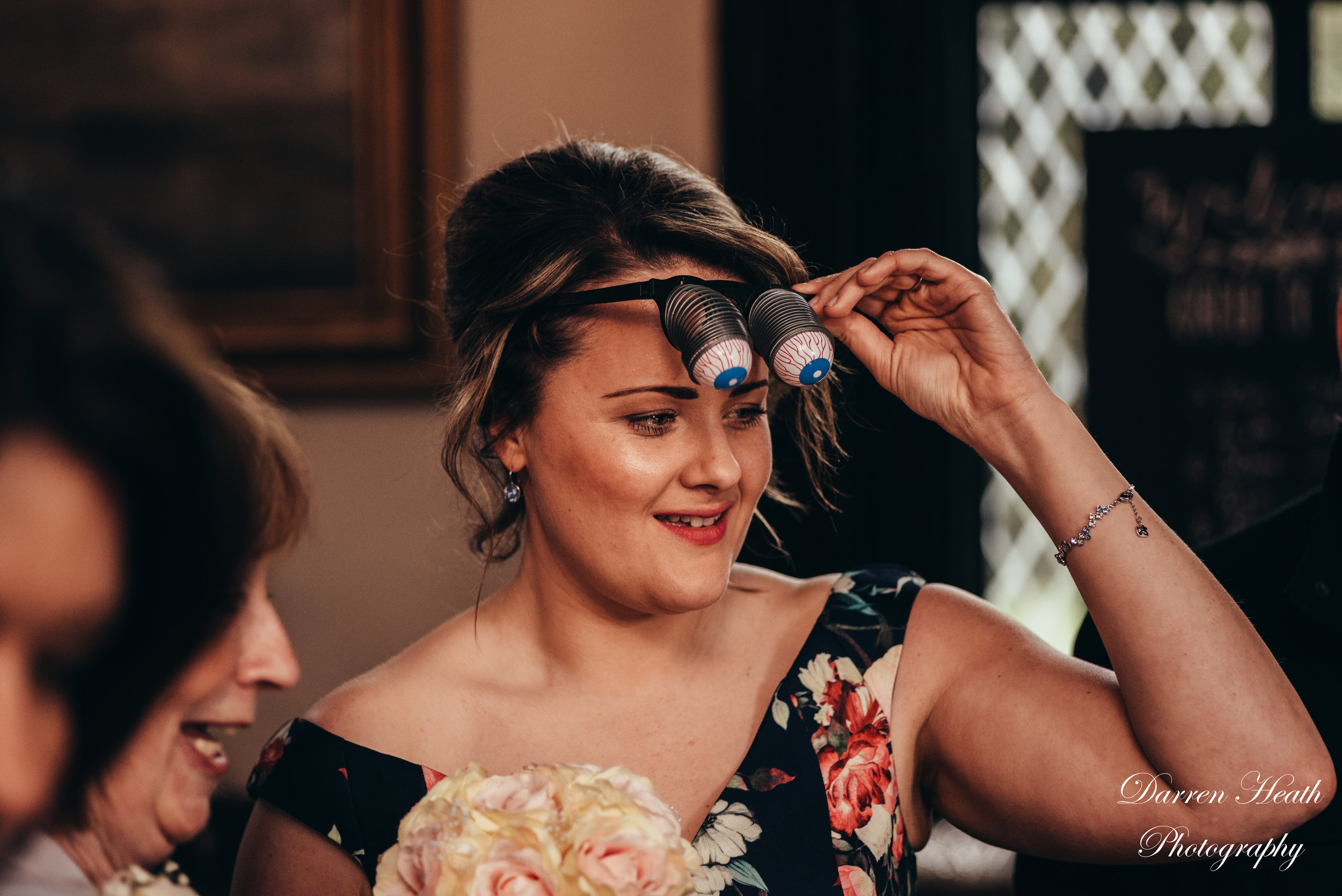 Google Eye props worn by a wedding guest