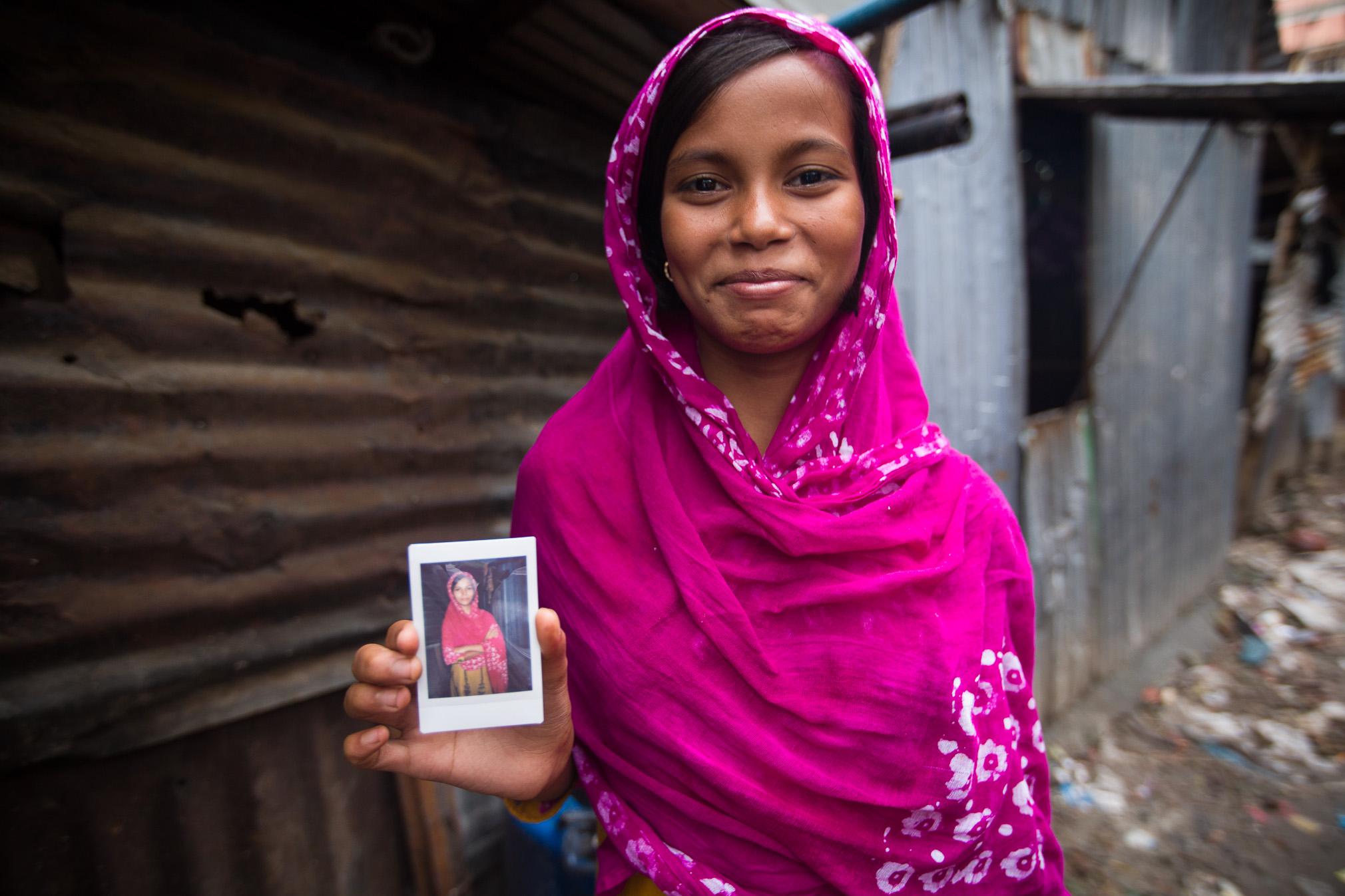 Holding a Fujifilm Instax print, Dhaka, Bangladesh