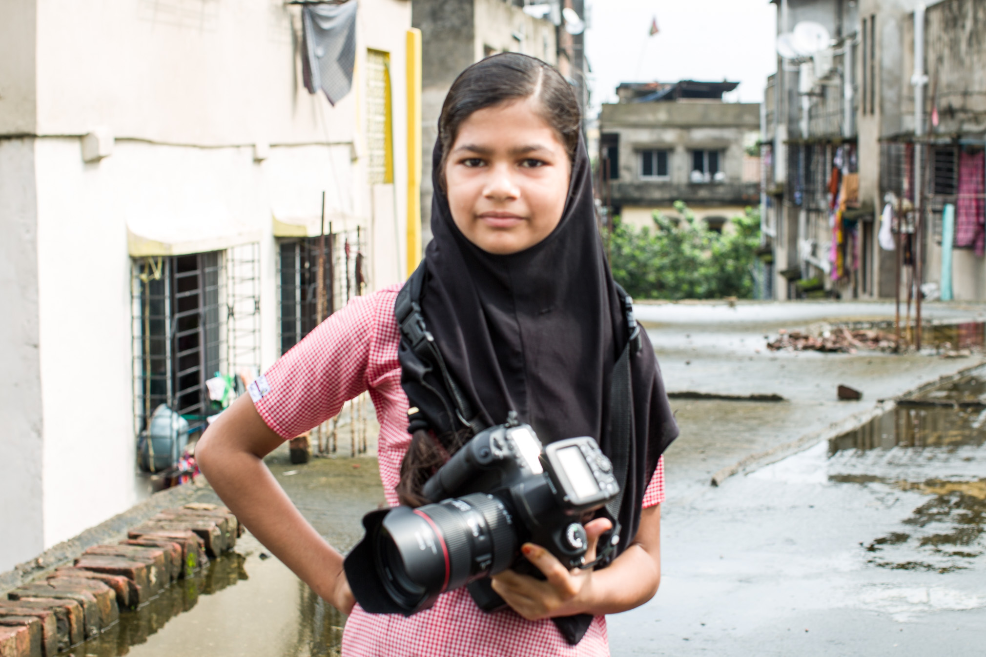 Schoolgirl with camera © Yasmine Kaddour