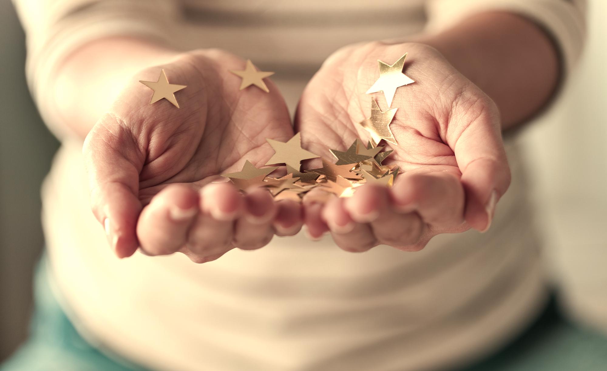 Girl holding gold stars