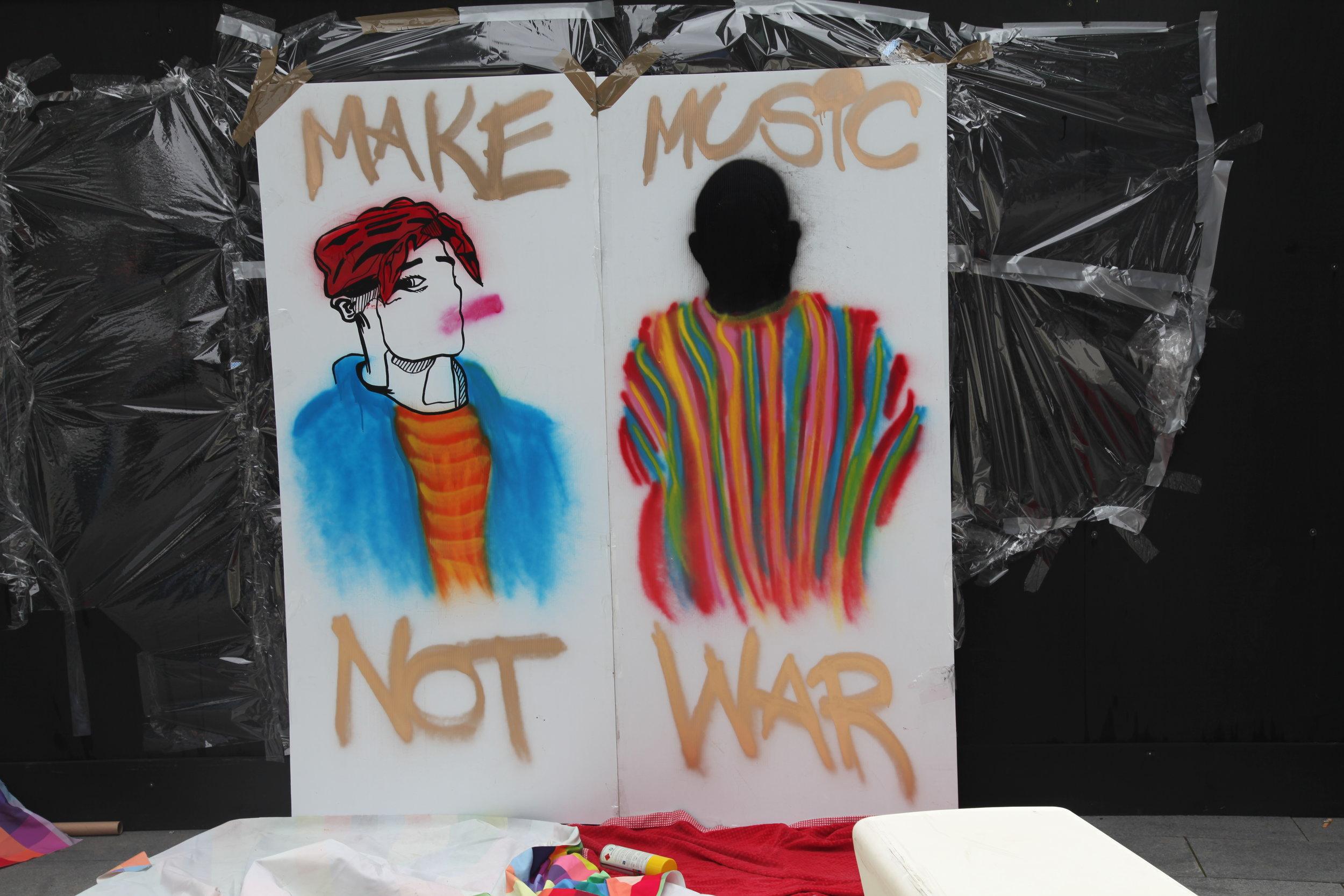 Street Art about making music not war 1789.JPG