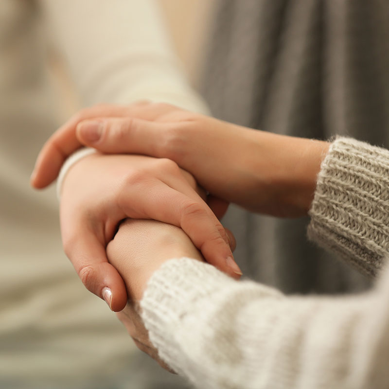 two hands holding and supporting each other