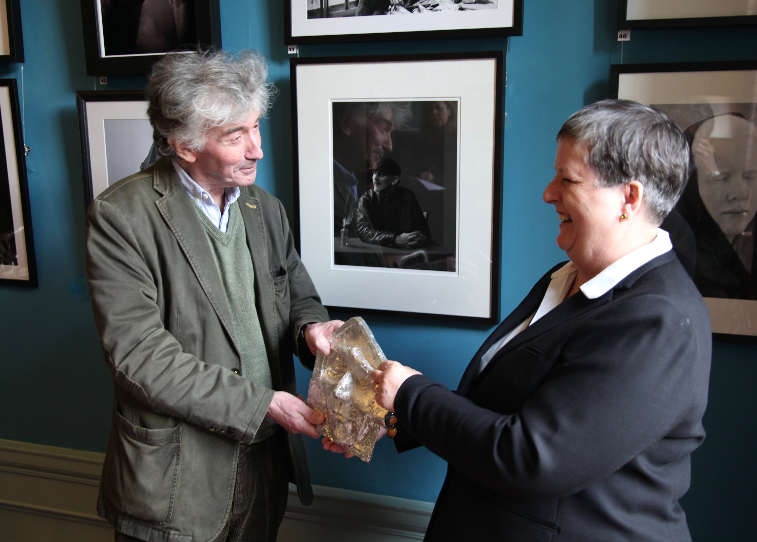 Robin Gillanders receives the Richard Coward SPA in Photography from Siobhán Coward, chair of the SPA Photography Panel.