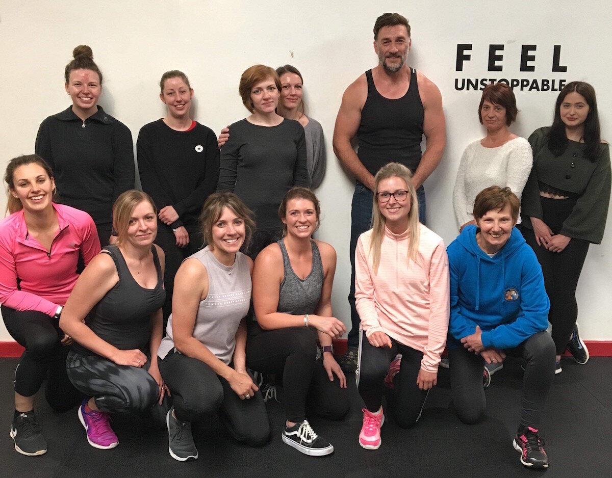Dene teaching a self defence class for women
