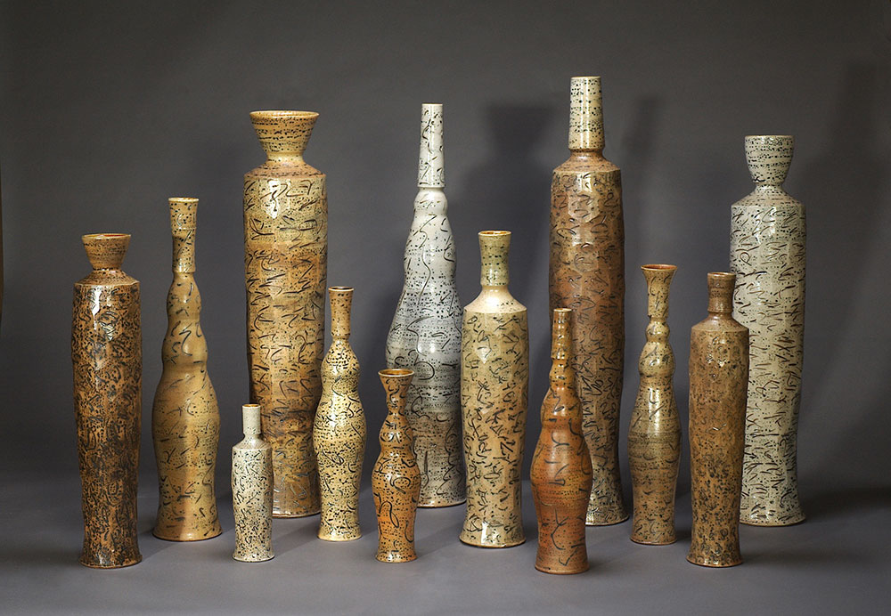 "1.  Bottle Group , wood-fired, salt-glazed stoneware, tallest 51""h (2008)"