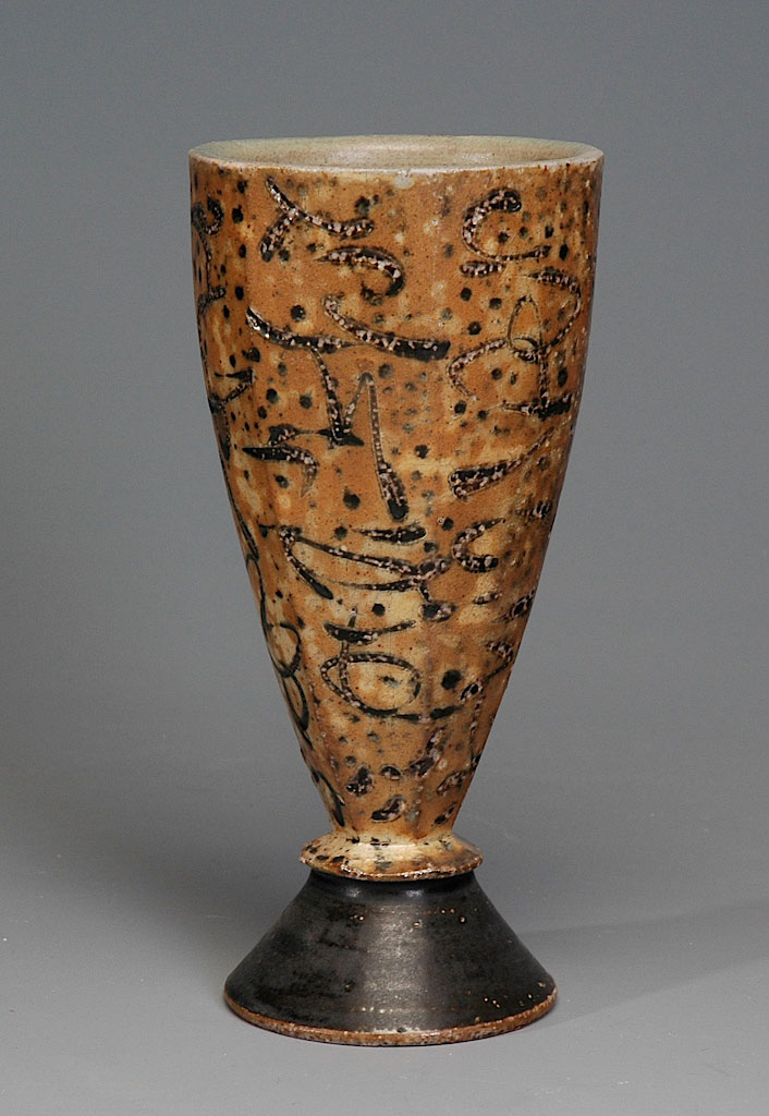 Faceted footed cup with markings
