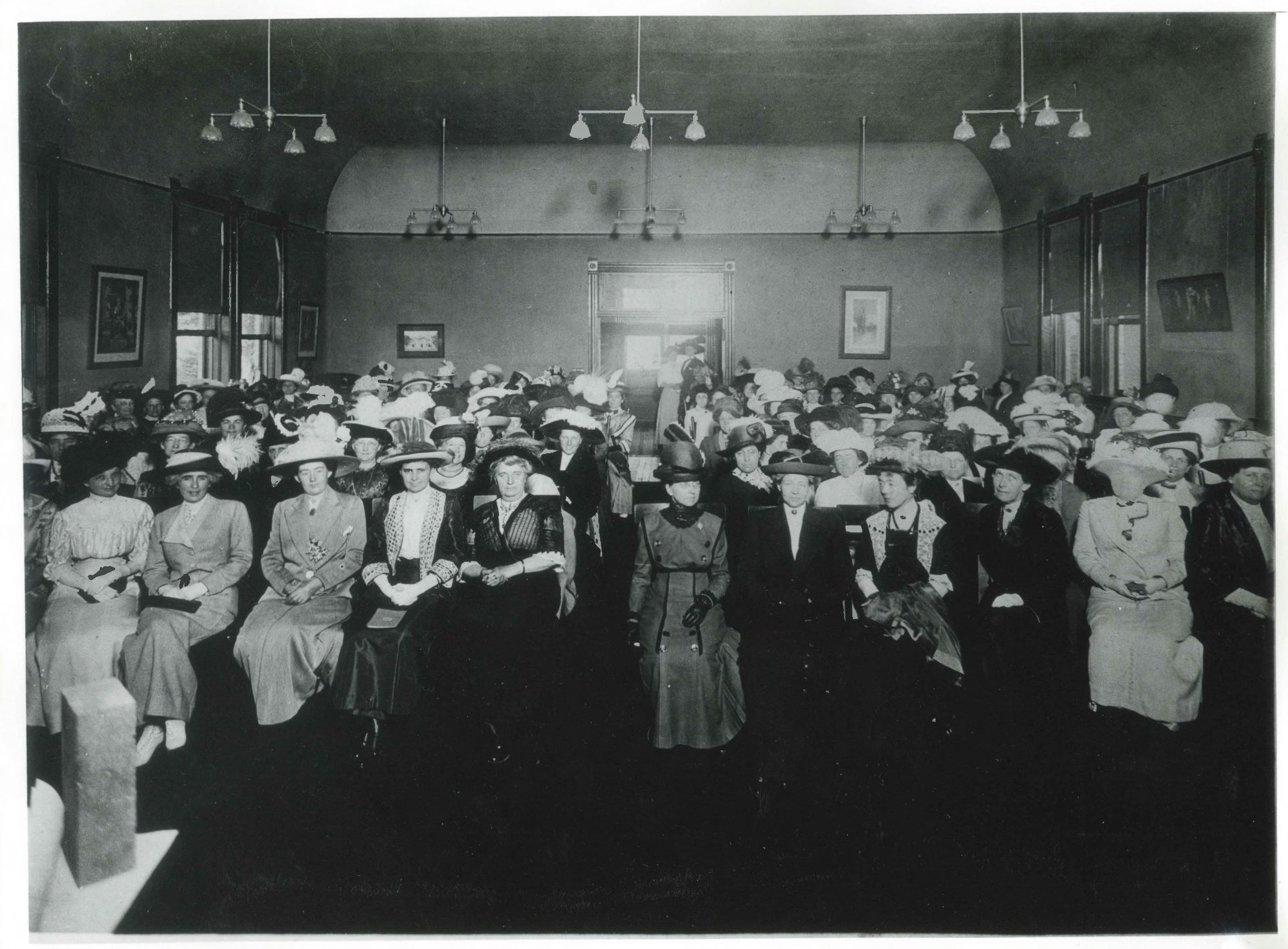 1910: Only known photograph of a general club meeting, taken in their first club house at 50 S 300 E. This building was sold to purchase the land for their new club house at 850 E South Temple. Image courtesy of Utah State Historical Society