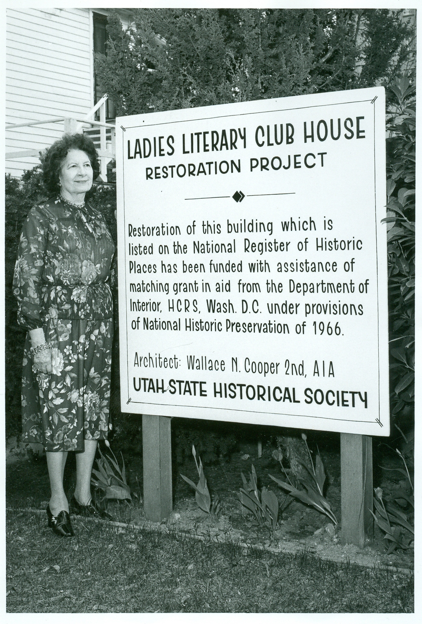 Image of former Ladies' Literary Club member in front of project board for restoration grant in 1966. Image courtesy of the Utah State Historical Society.