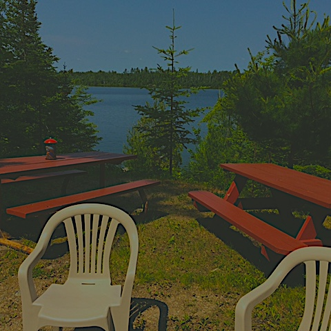 Picnic Area - Picnic tables and a campfire pit overlook Tofte Lake and its remarkable dinnertime sunsets.