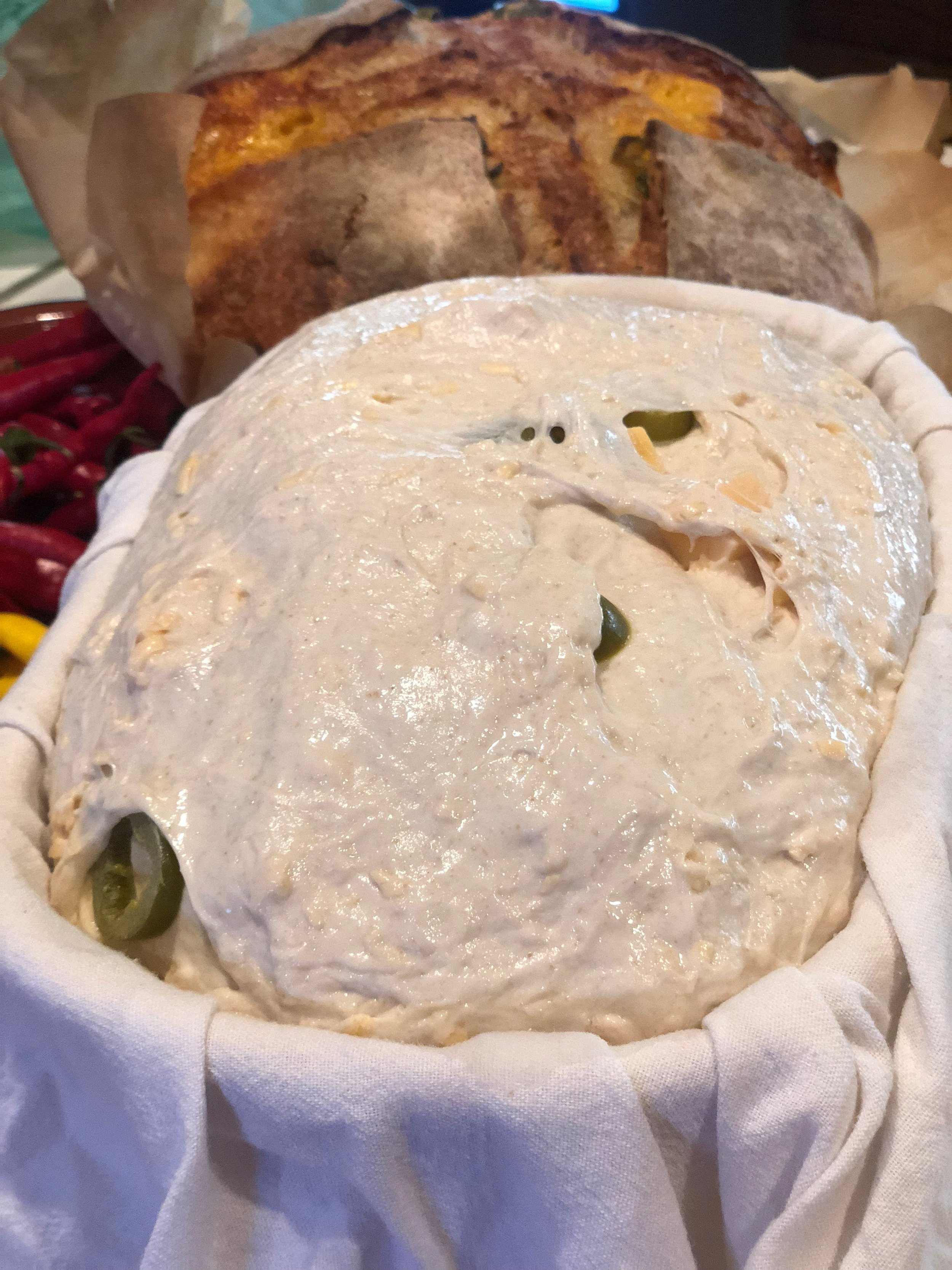 The dough has completely filled the proofing basket and is ready to be baked in the bread cloche and a 500 degree oven.