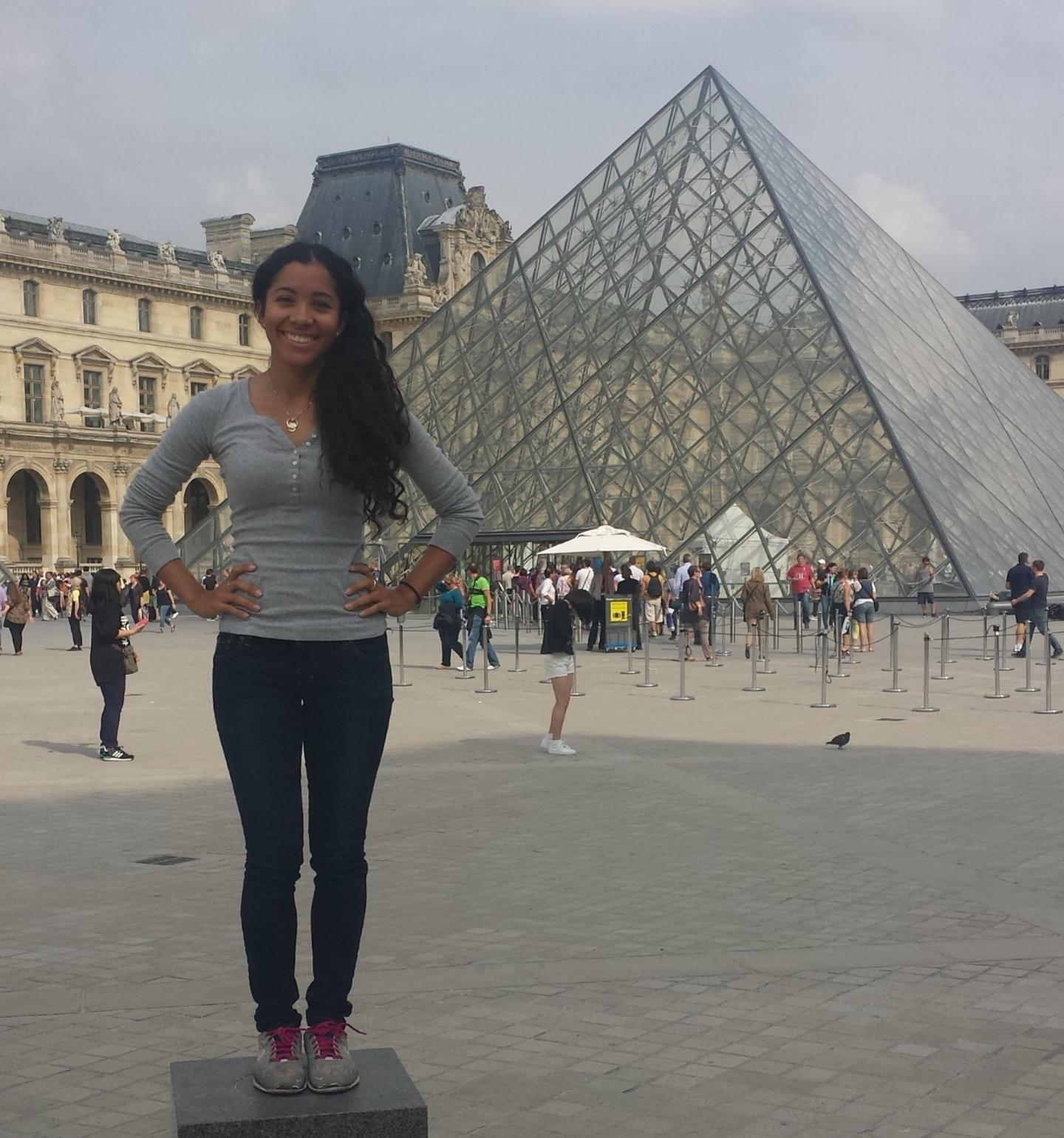 Standing outside the Musee de Louvre in Paris