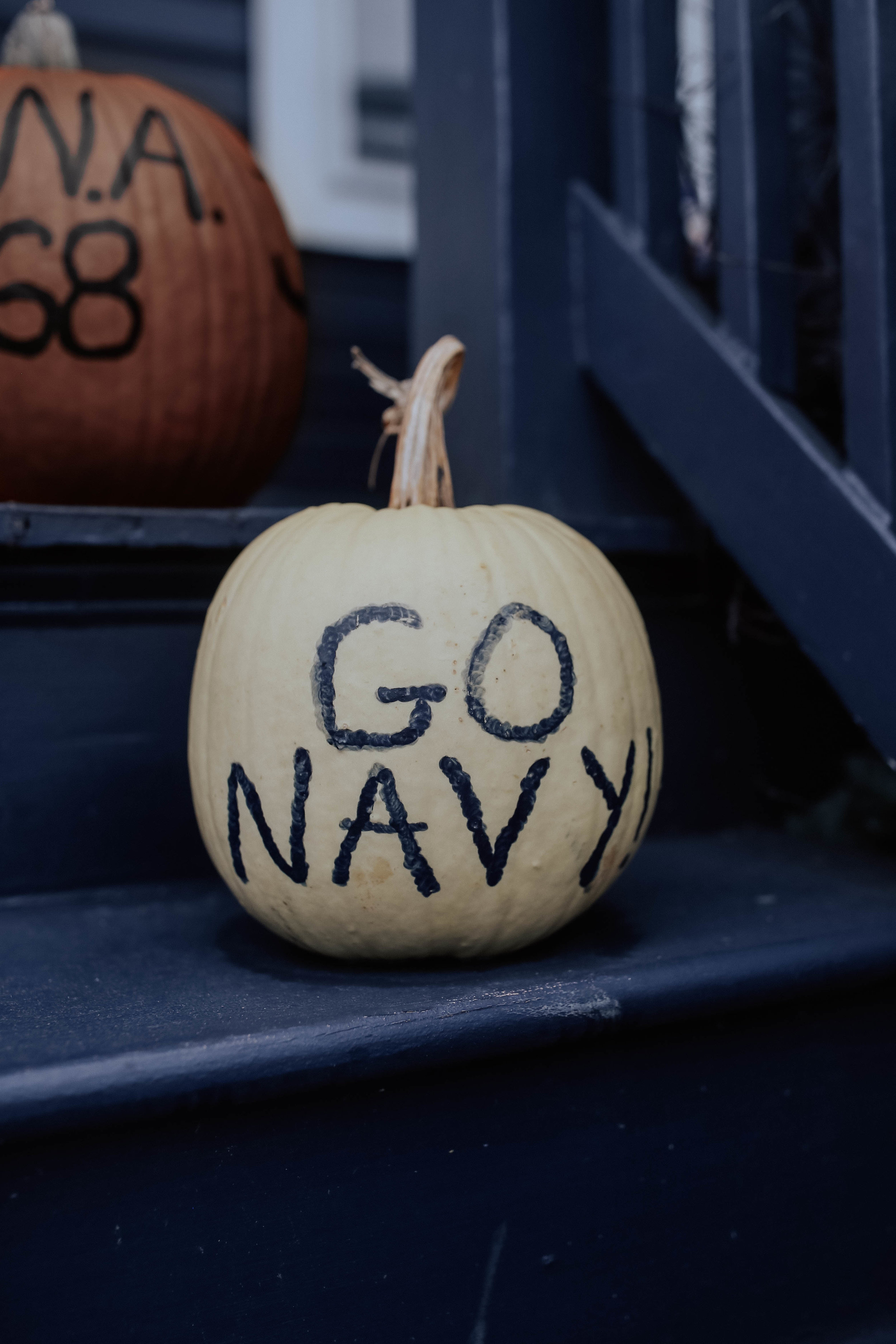 """- hi! these photos are from last weekend when we were in Annapolis.i have been to quite a few universities (give or take the one time i refused to get out of the car because """"there was too much concrete"""" 🤦🏻♀️) and i have to say the Naval Academy is second to NONE.the way in which the midshipmen conduct themselves is so admirable and you can't walk around without thinking about how accomplished and disciplined everyone is. just look at their daily schedule and you'll see what i mean.my dad was a gymnast so we got to visit the current team at practice - i honestly tried to not make a lot of eye contact because when i tumbled (manyyyy years ago) i used to hate visitors at practice cause i would always mess up more. so i didn't actually watch too much but what a talented bunch. i mean the entire campus just screams talent. but more importantly.. the hard work to back it up.we also went to the game + tailgate as part of the reunion festivities. the entire school gets in formation at the start of the game, so it is more customary for them to tailgate after the game, but the regular people tailgate before.lastly (although these photos come first in the blog post 🤷🏻♀️), the town of annapolis is so pretty! i loved seeing all of the houses decorated for fall (especially the go navy pumpkins!) and if you ever visit, you must stop by Old Fox books!not gonna lie, i have no food recommendations because there was a Chipotle at the mall. and sometimes you need to eat at a chain to combat homesickness, ya know?thank you for reading 💙"""