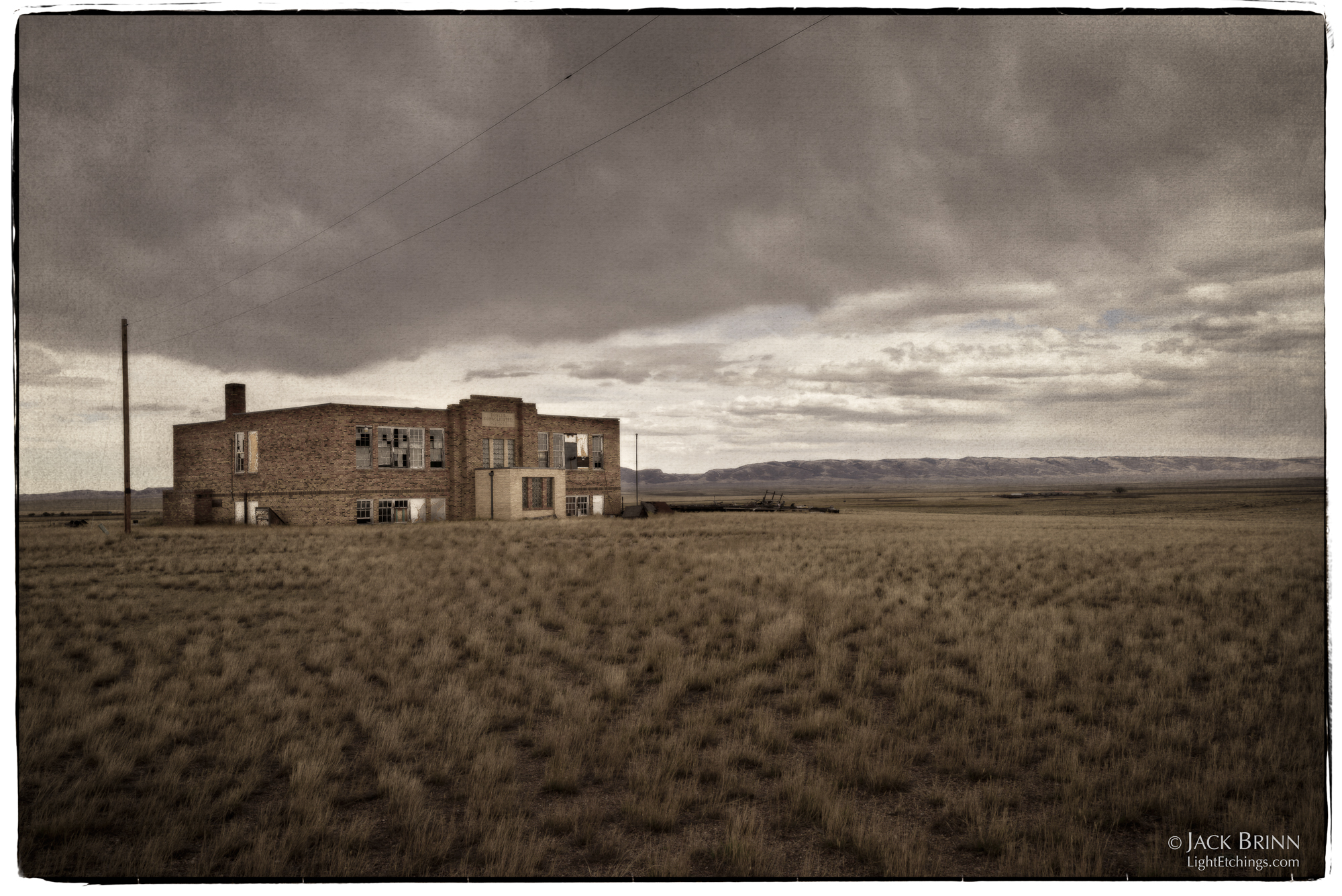 The Bosler Consolidated School sits starkly empty on the plains on the north side of town. There are miles of open space between the school and the distant Laramie Range forming the horizon. There's a road over there in the distance, where cars are mere specks.