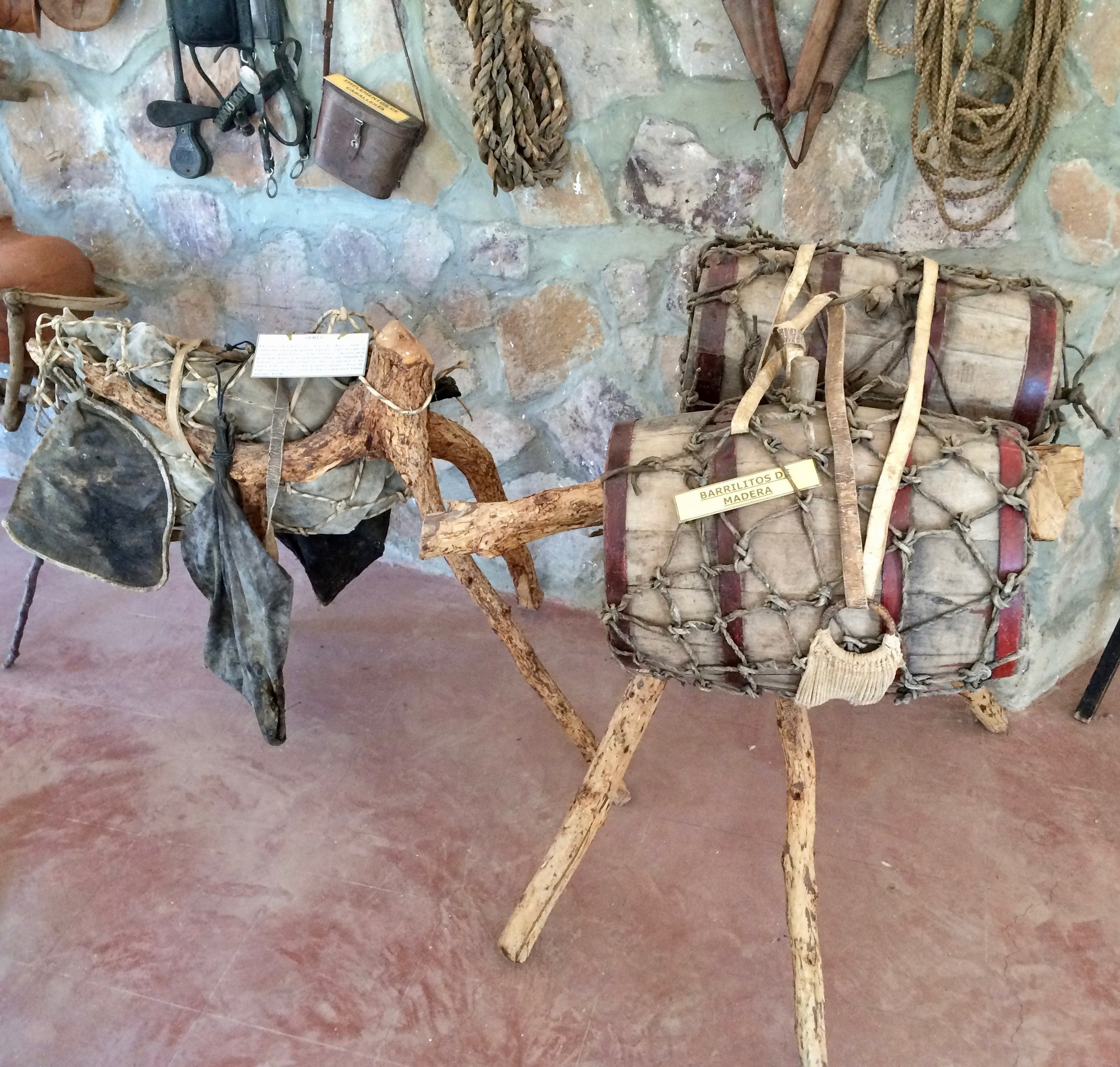 An exhibit in the Ethno-Anthropological Museum of Cinti, located in Camargo, Chuquisaca showing the evolution of containers for the transportation of wine and Singani from clay pot and pouches made of animal skins or intestines, and eventually wooden barrels.