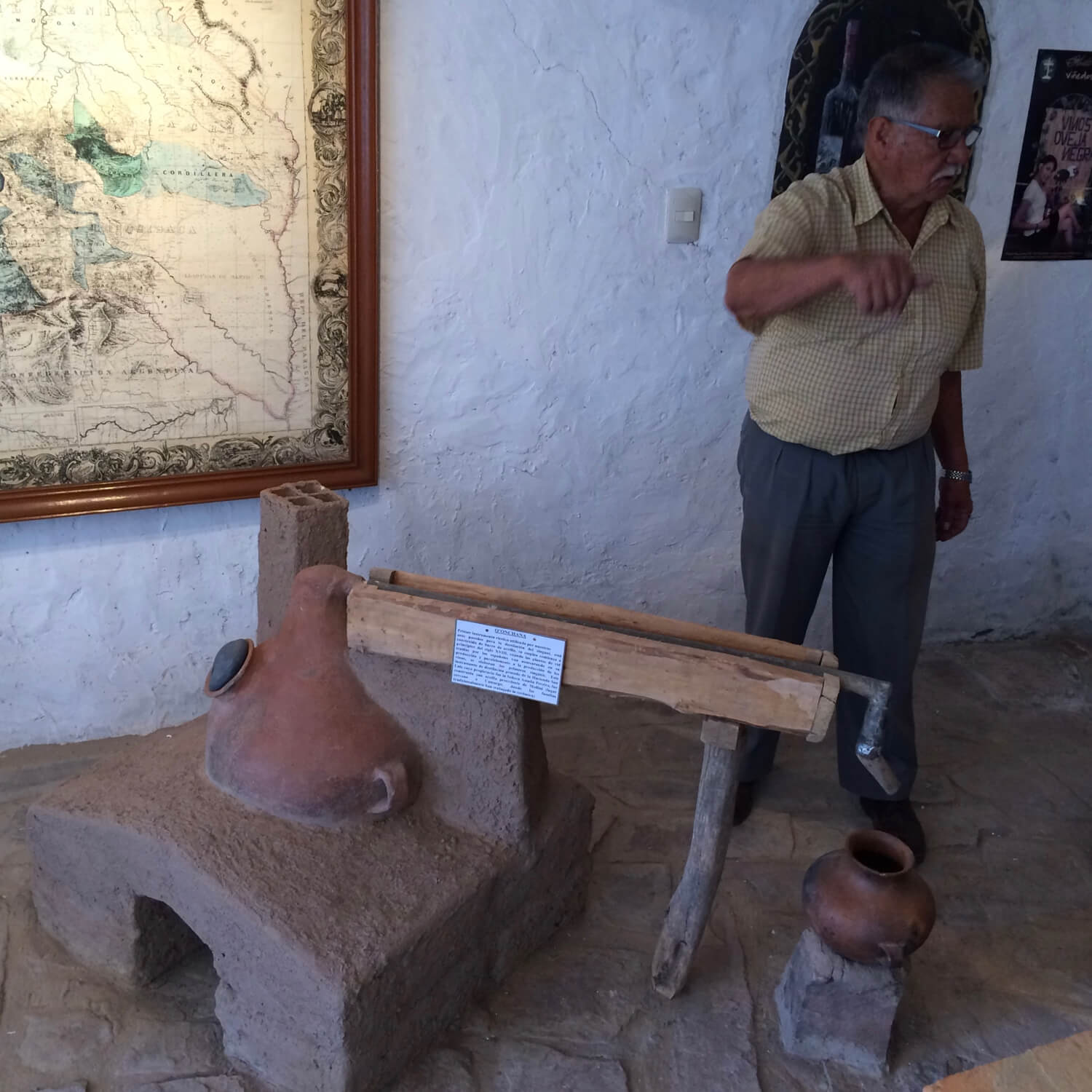 The founder of the Cinti Valley Museum of Anthropology and Enology explains the traditional method of Singani distillation in a Falca still.