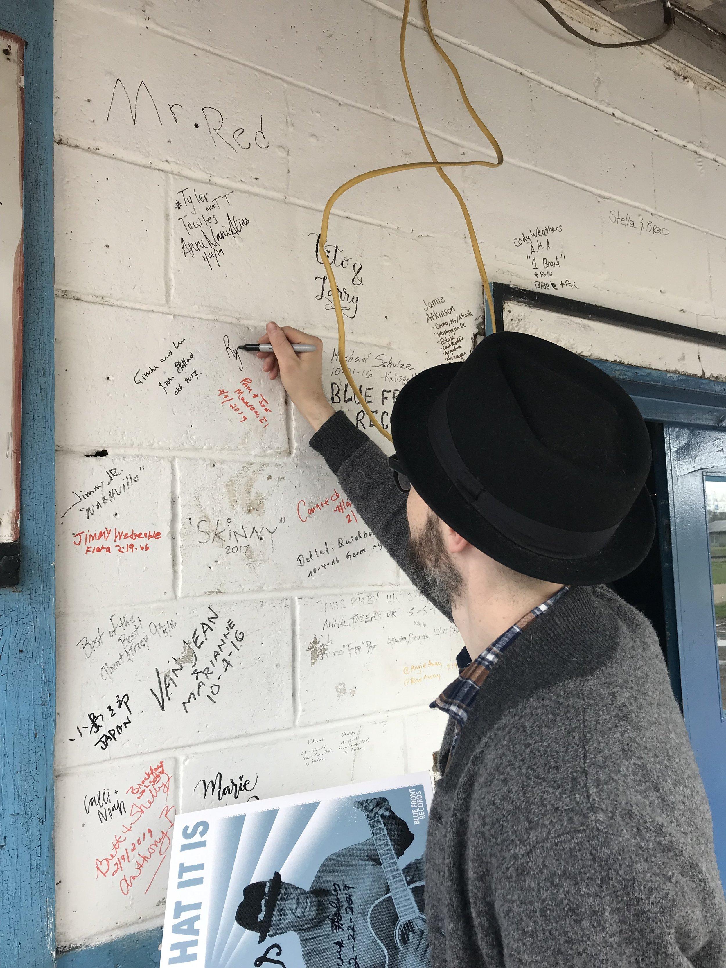 Signing the Wall.jpeg